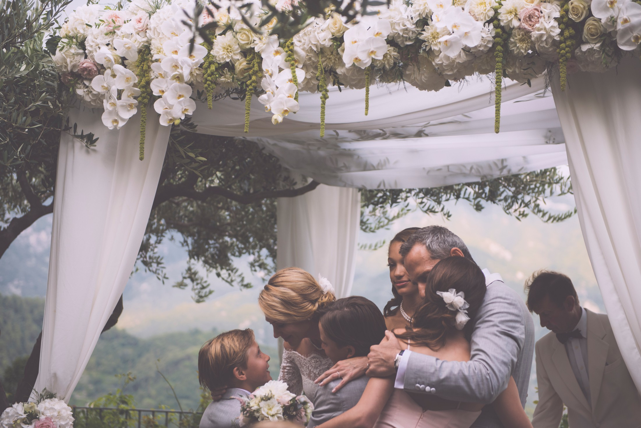 adriana alfano the bride and the groom holding their children after the wedding ceremony at hotel caruso ravello italy