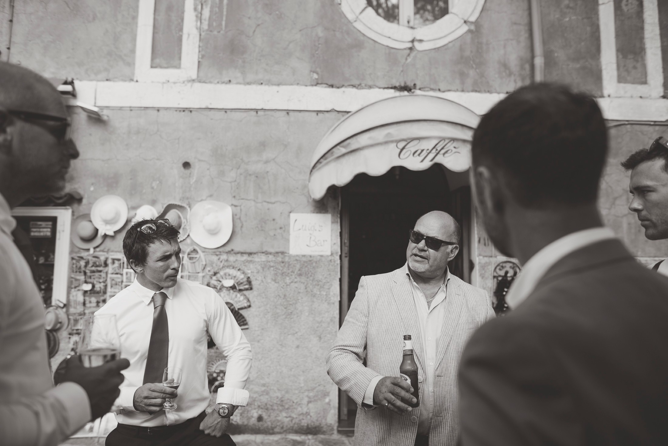 adriana alfano the groom with his best man and some friends having a beer before the wedding ceremony in ravello amalfi coast