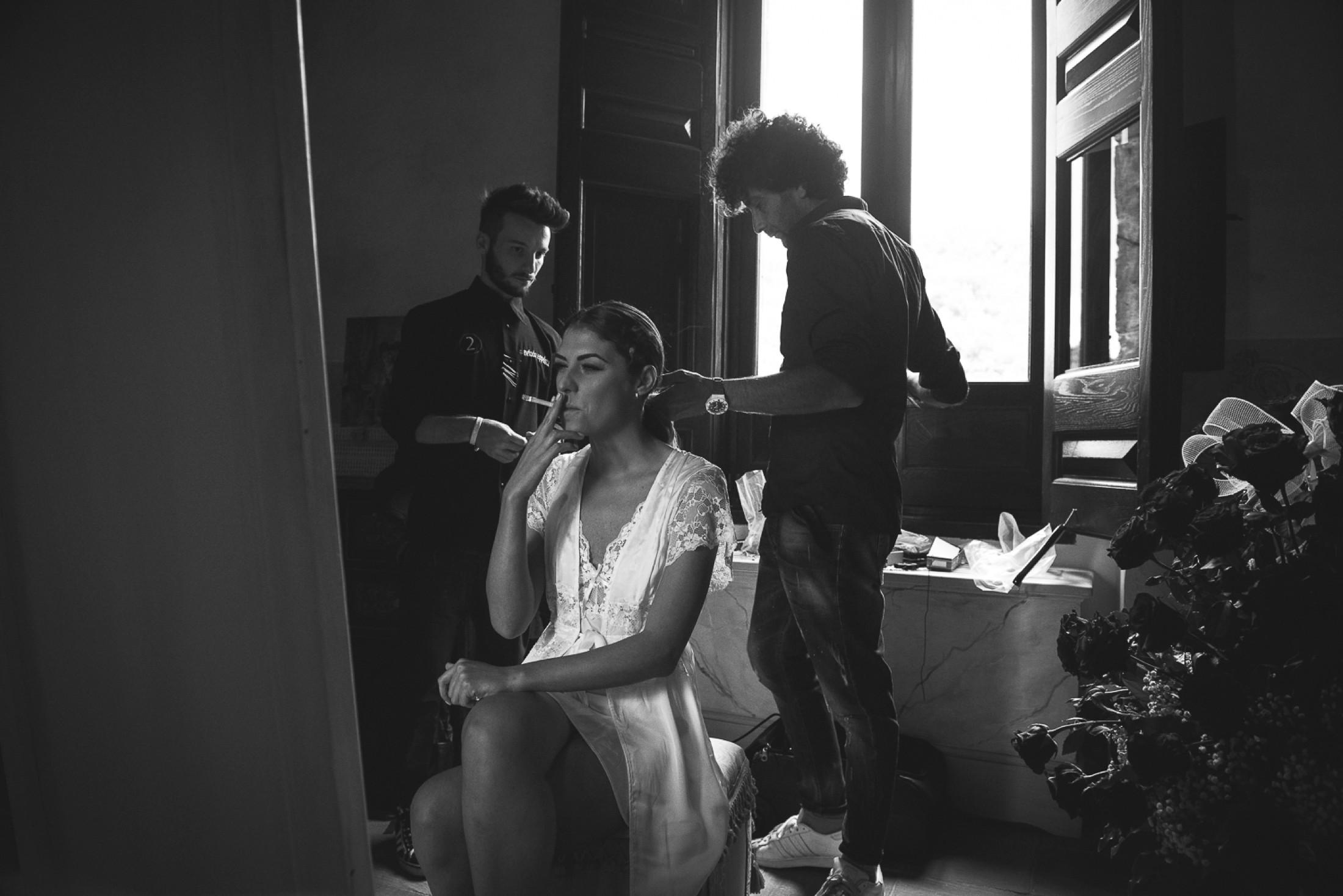 adriana alfano the bride smokes a cigarette during the make up