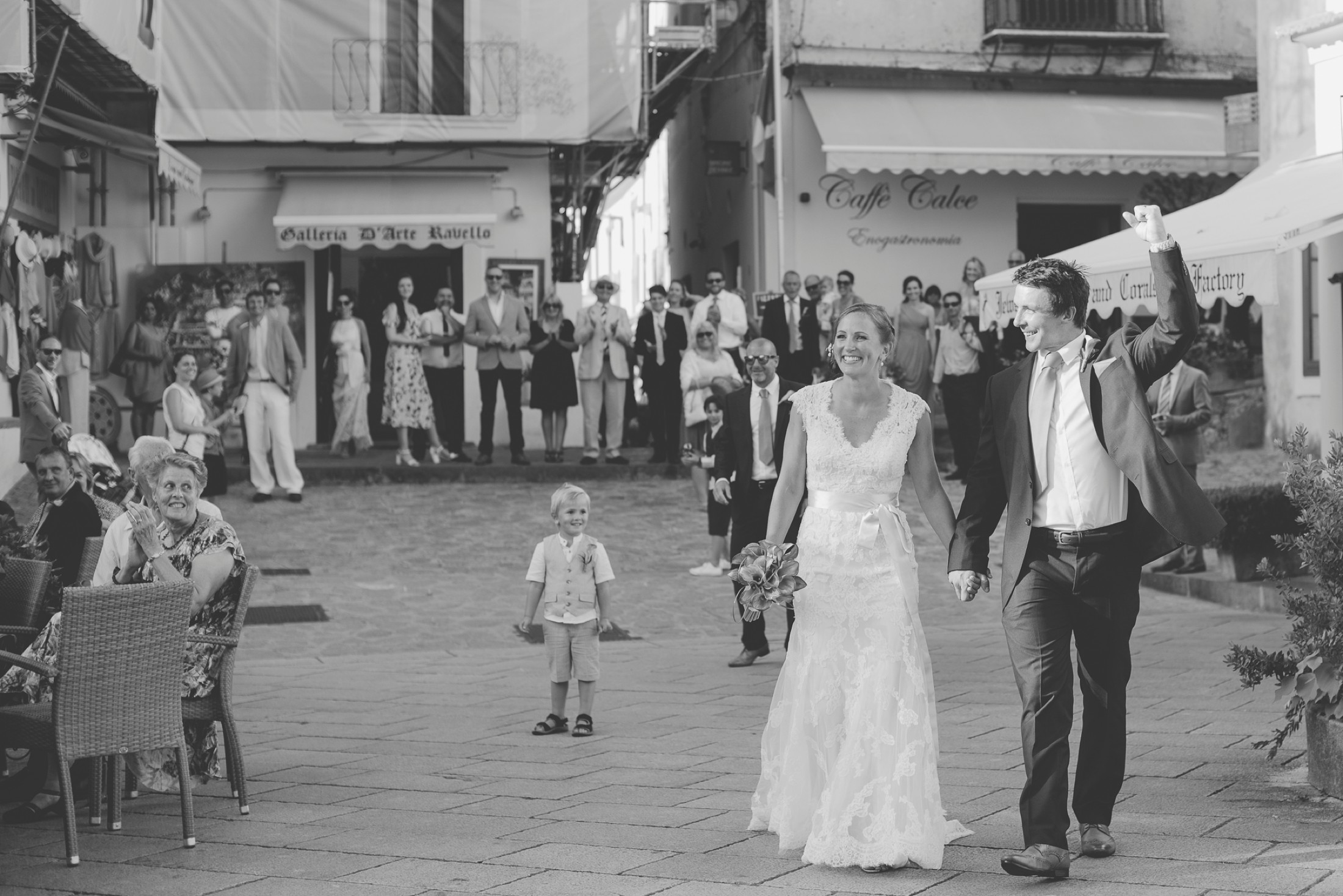 adriana alfano the bride and the groom walk through the ravello's main square after the wedding ceremony