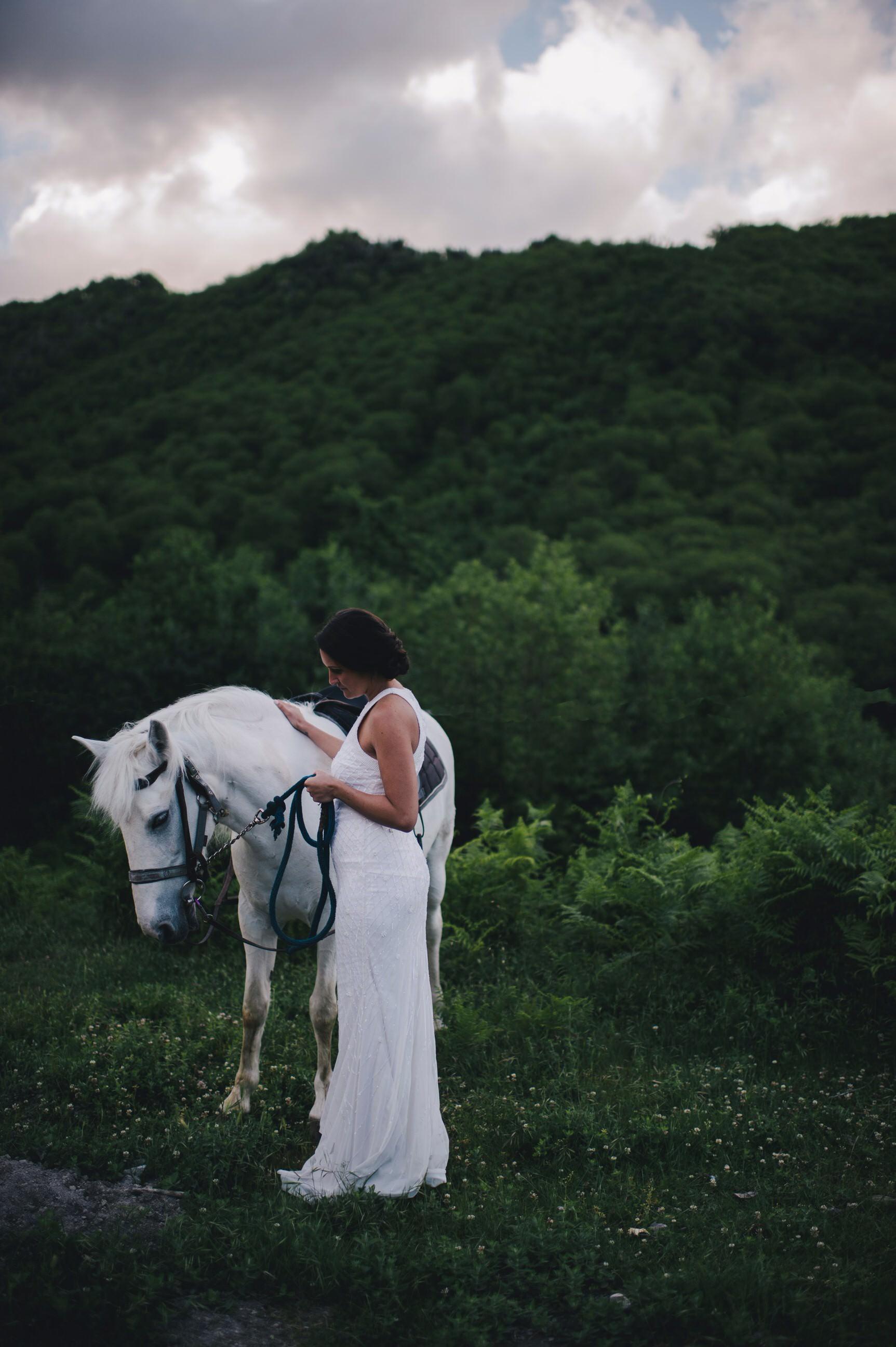 gianni di natale bride with a white horse