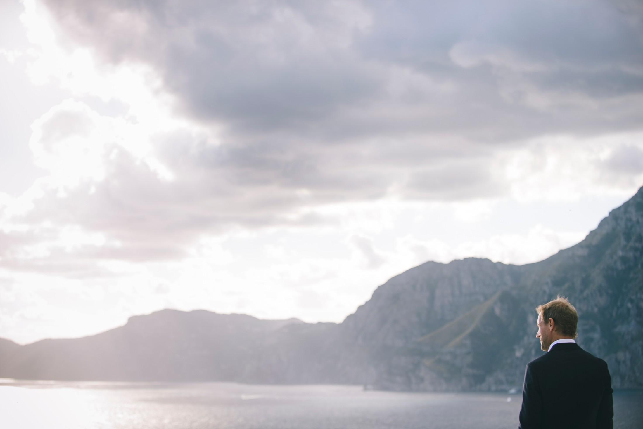 the groom looks at the sea in praiano amalfi coast italy