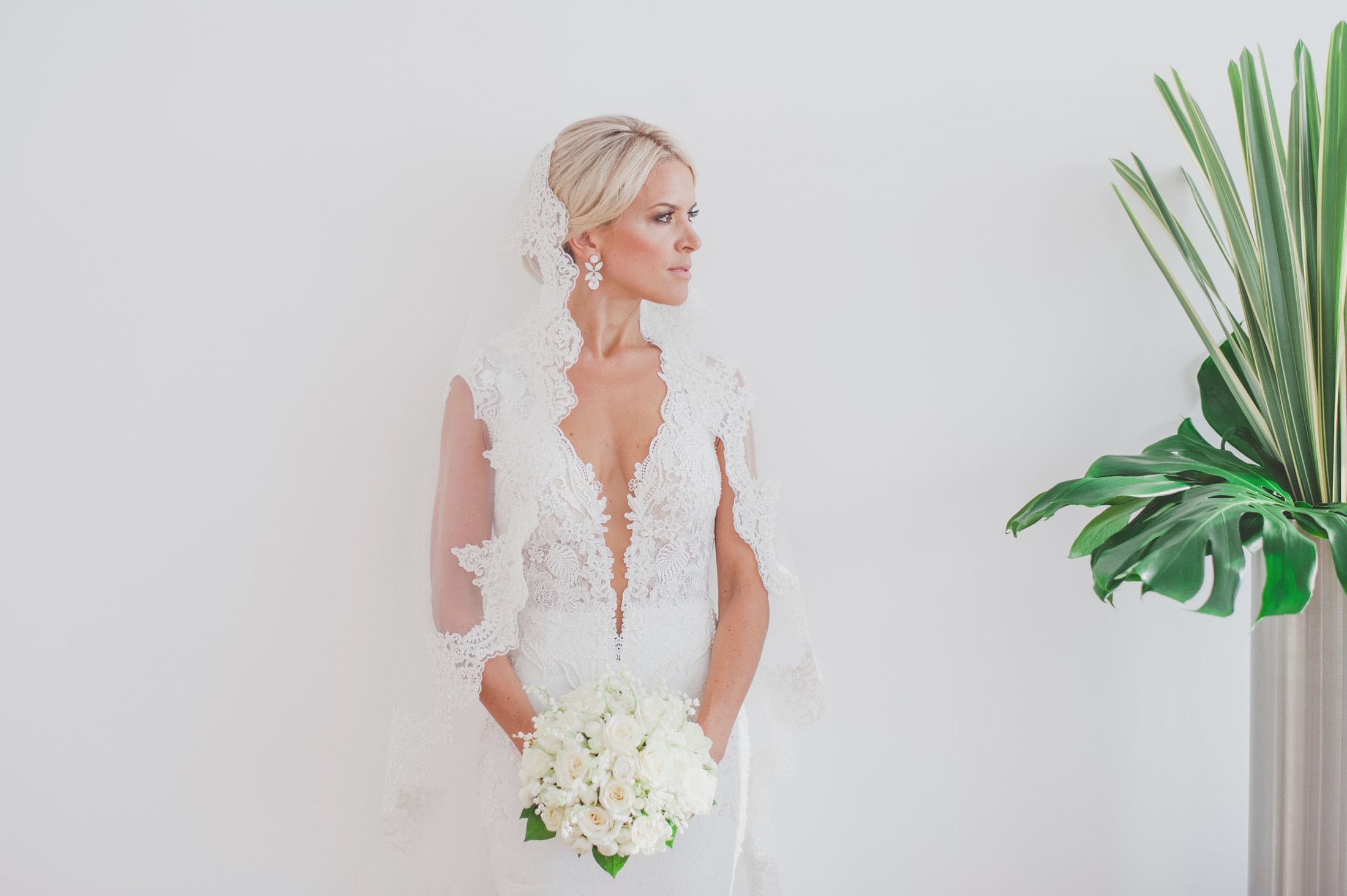 bride's portrait with a light green plant