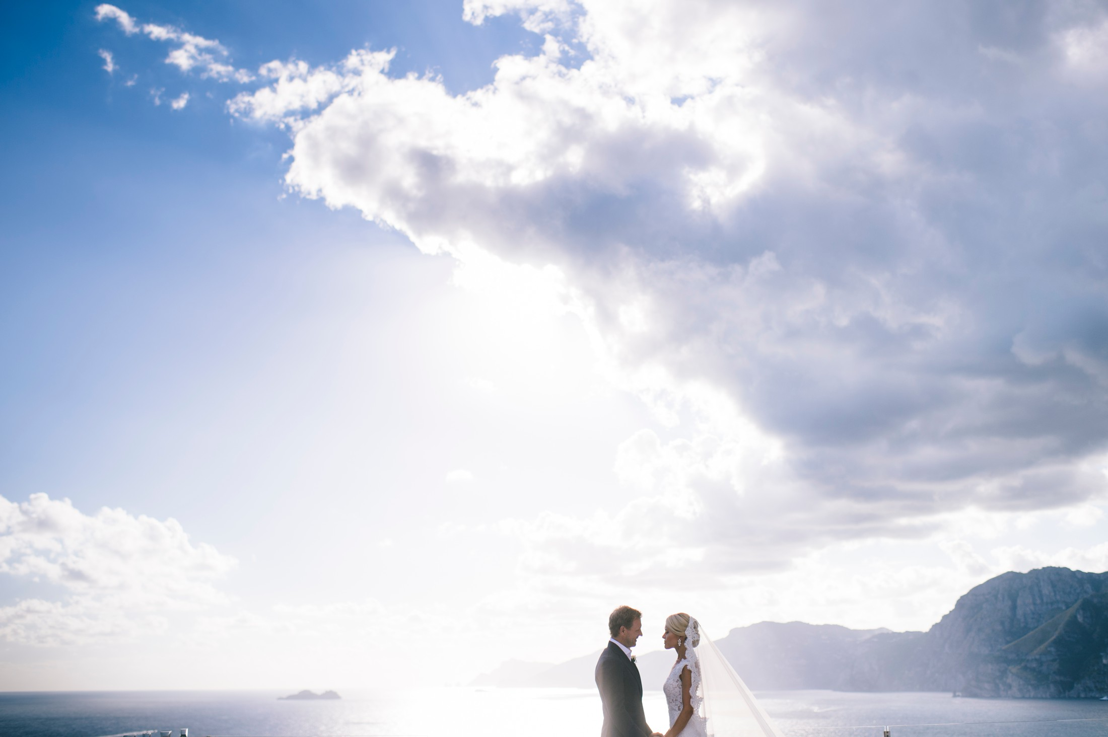 bride and groom's portrait with the sea as backdrop