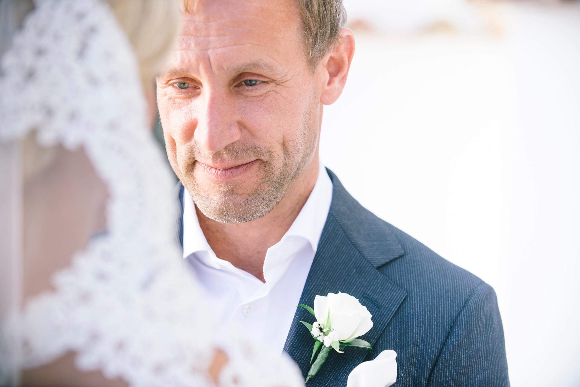 the groom looks in his bride's eyes