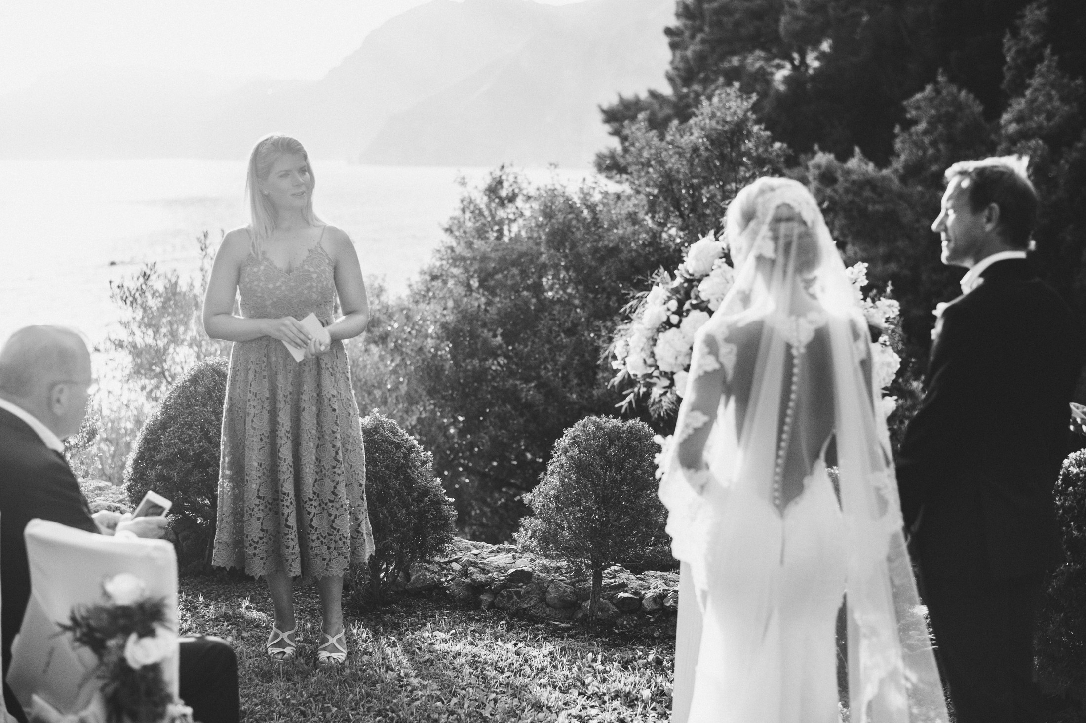 woman reading sometginh to the bride and the groom during the wedding ceremony at casa angelina in praiano