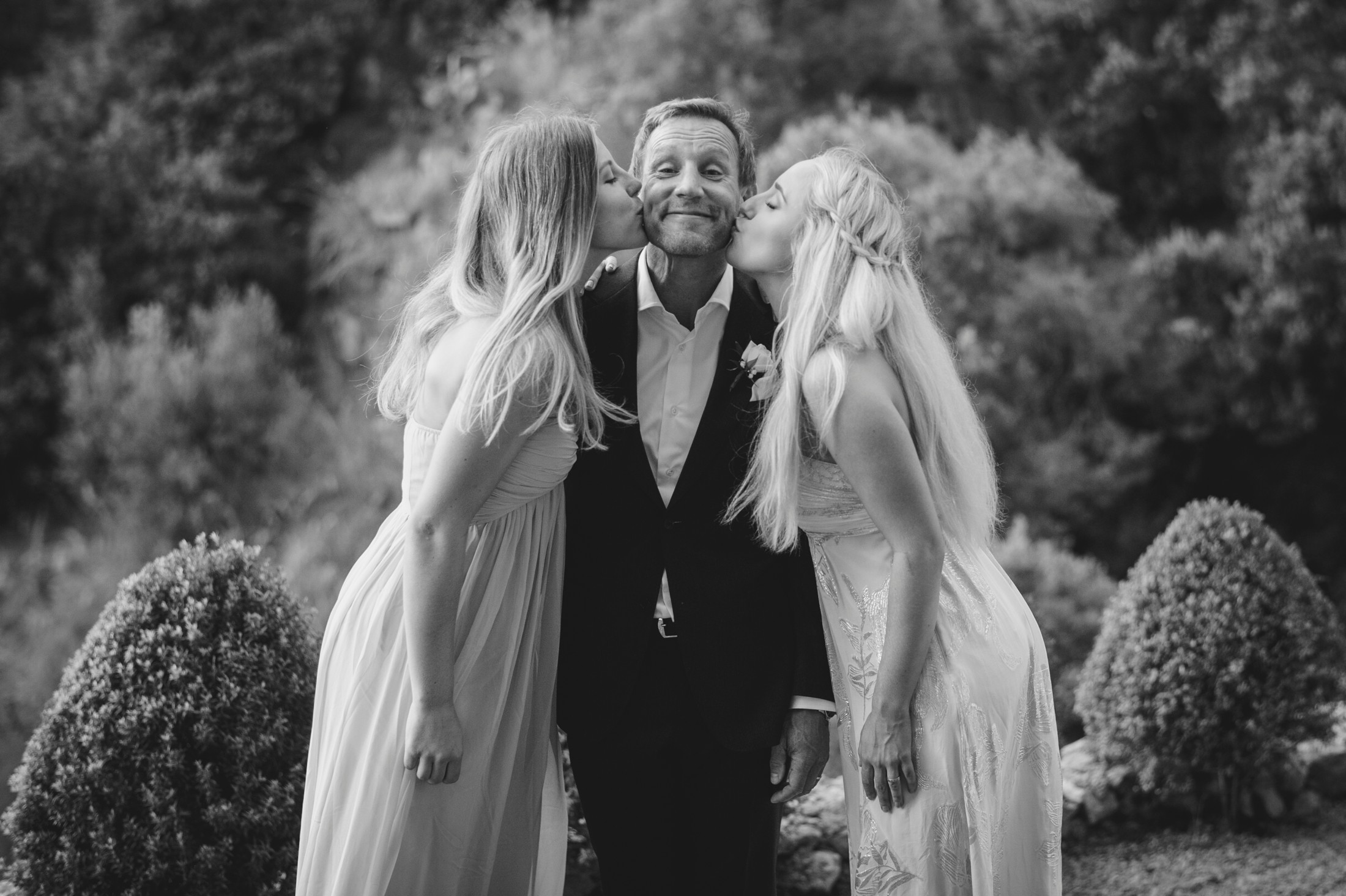 the groom' kissed by his two daughters