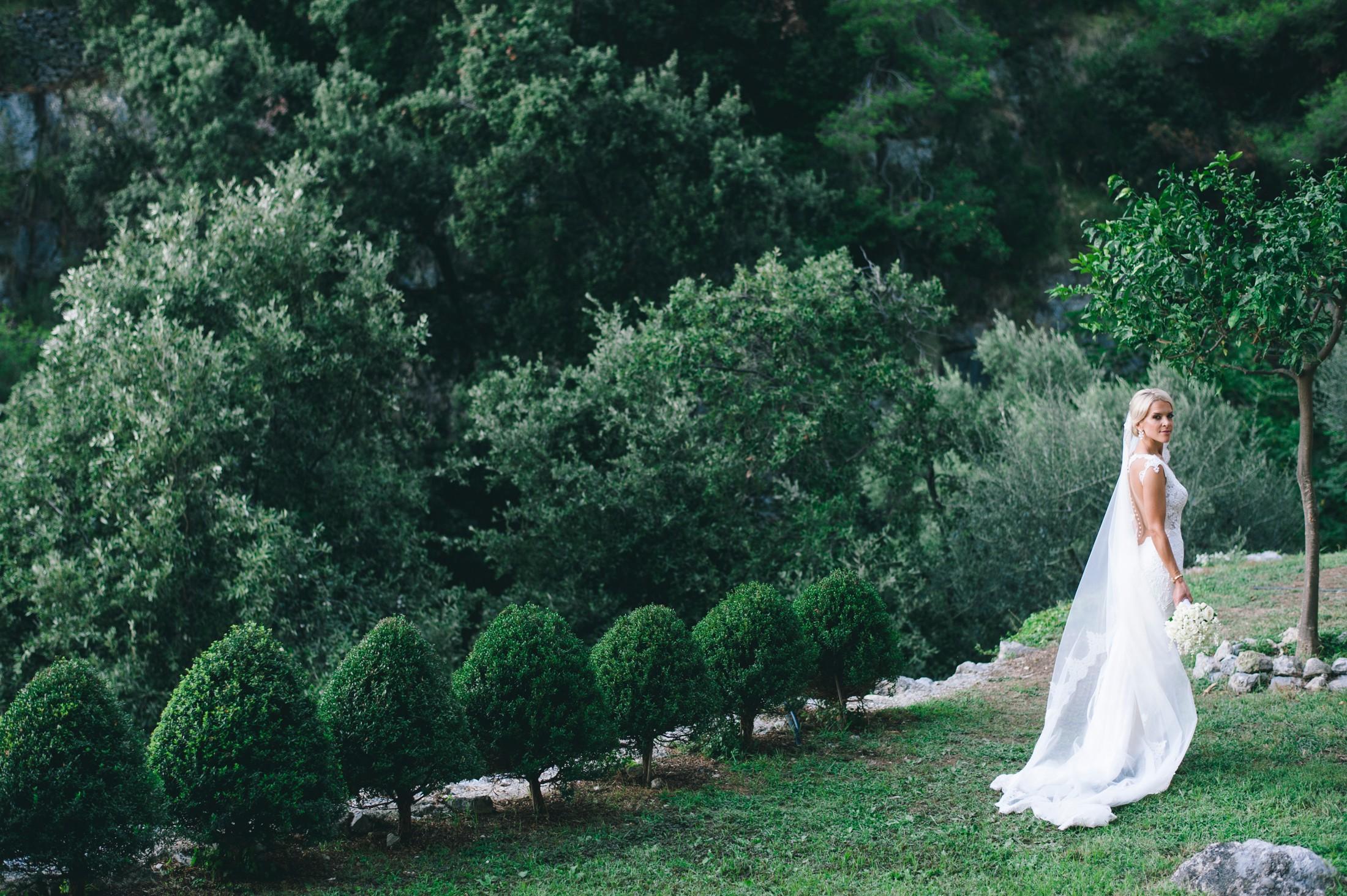 bride's portrait in a green garden at casa angelina