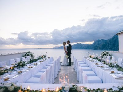 bride and groom behind the wedding table set on the terrace of casa angelina in praiano amalfi coadt