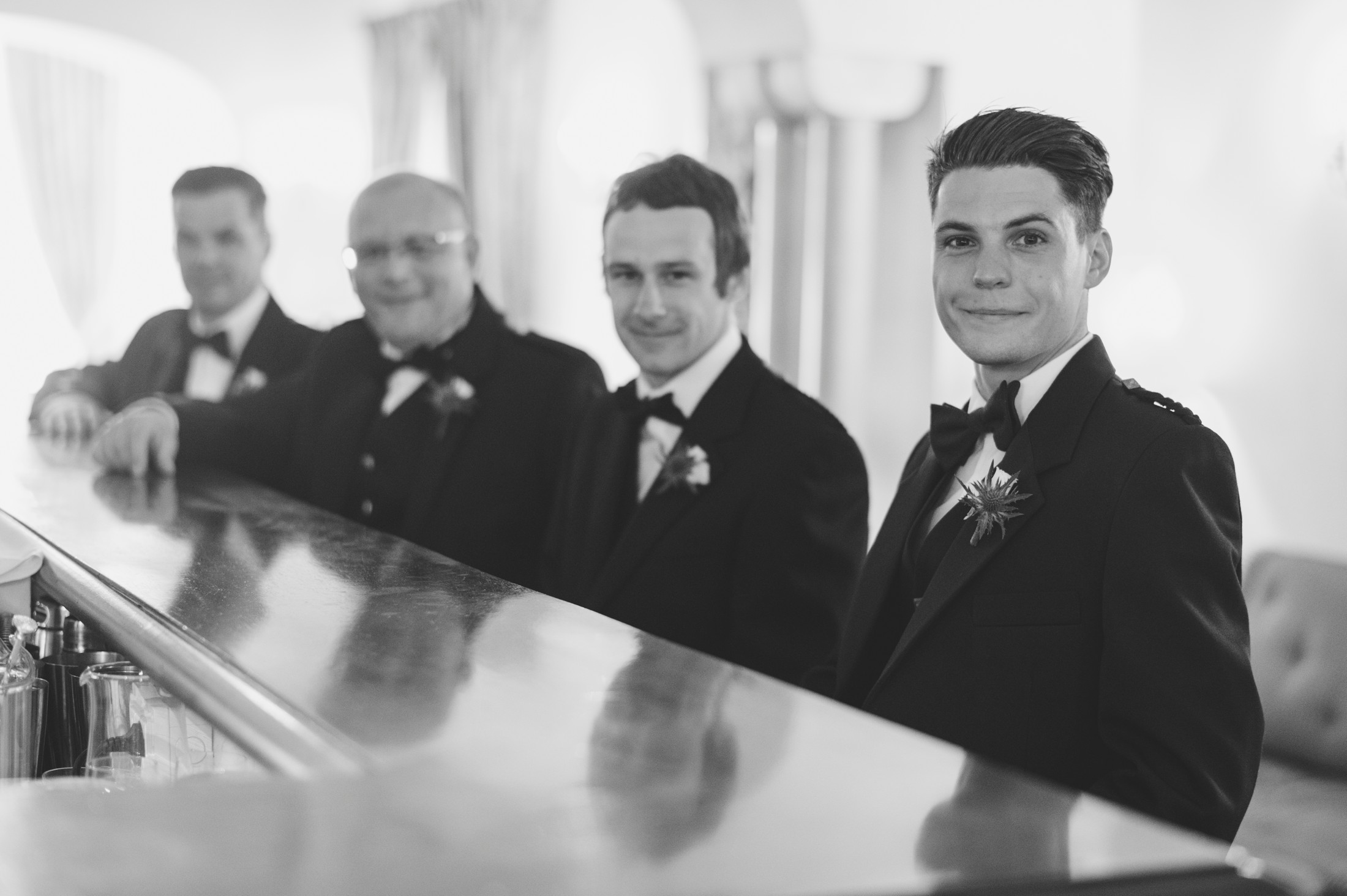 the groom and other best men at the hotel caruso bar