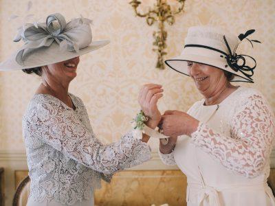 two women with hats wearing a bracelet