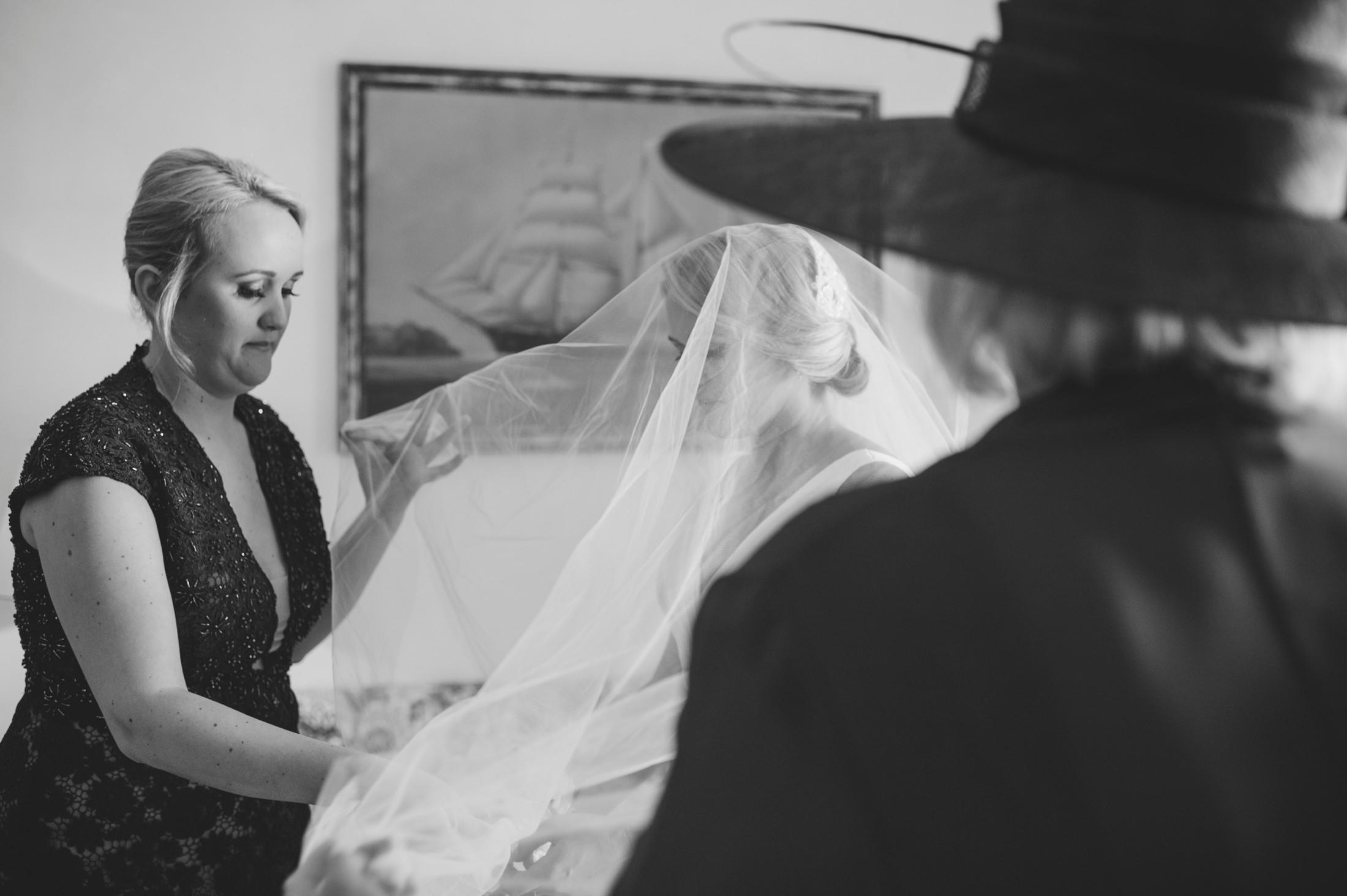 the bride wears her wedding veil