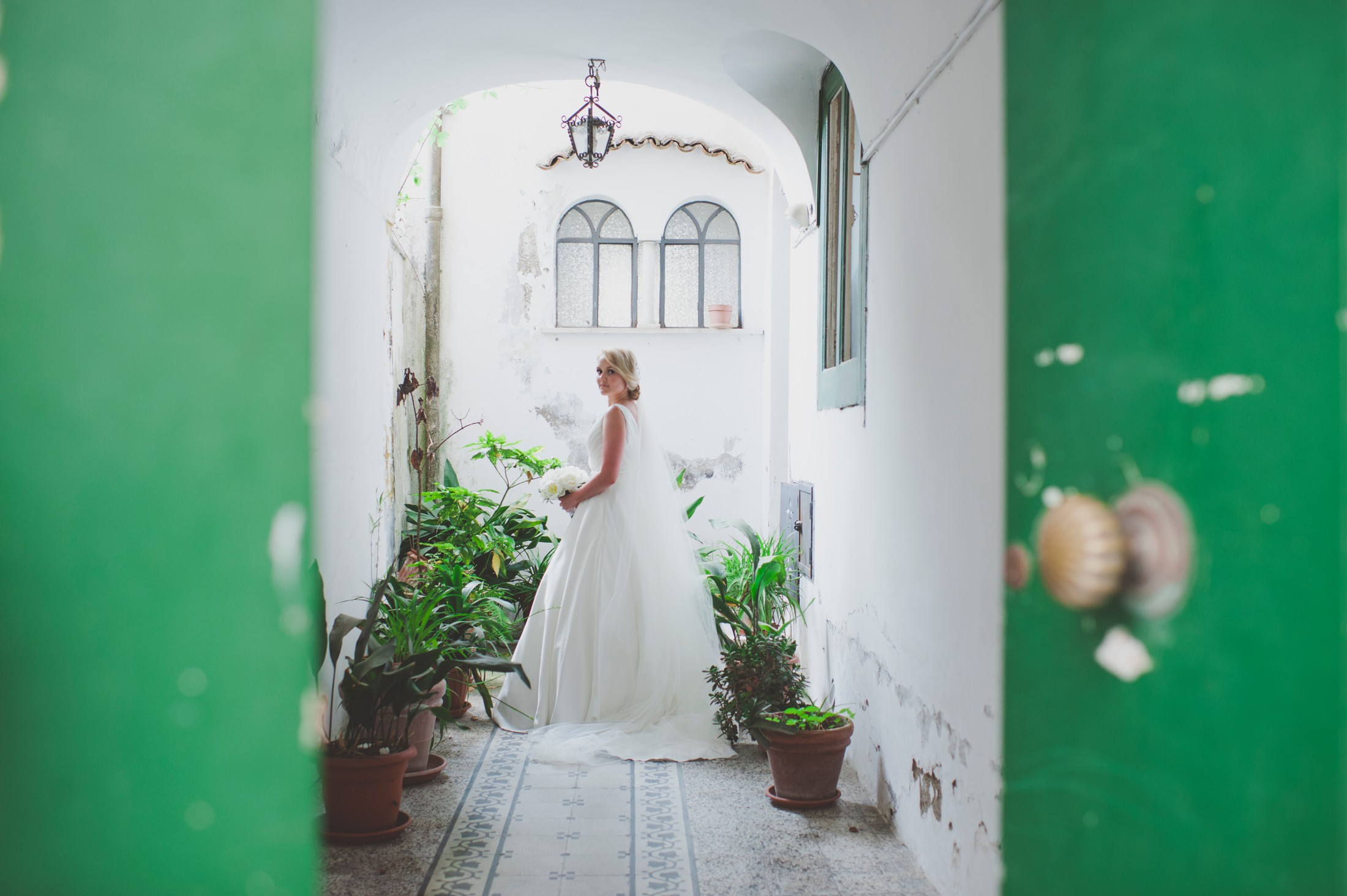 bride's portrait with a light green door