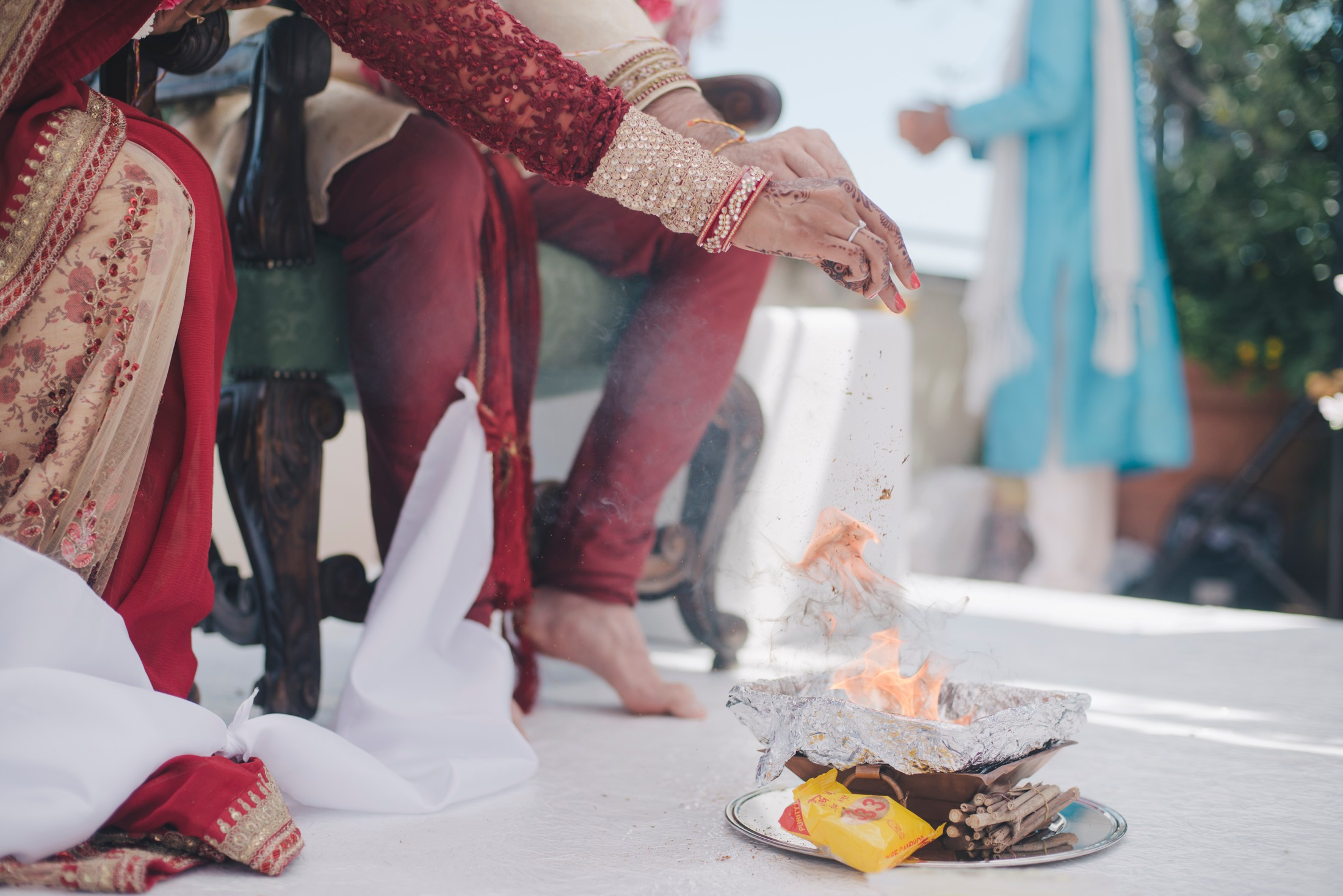 bride and groom's hands during a traditional indian wedding ritual with the fire