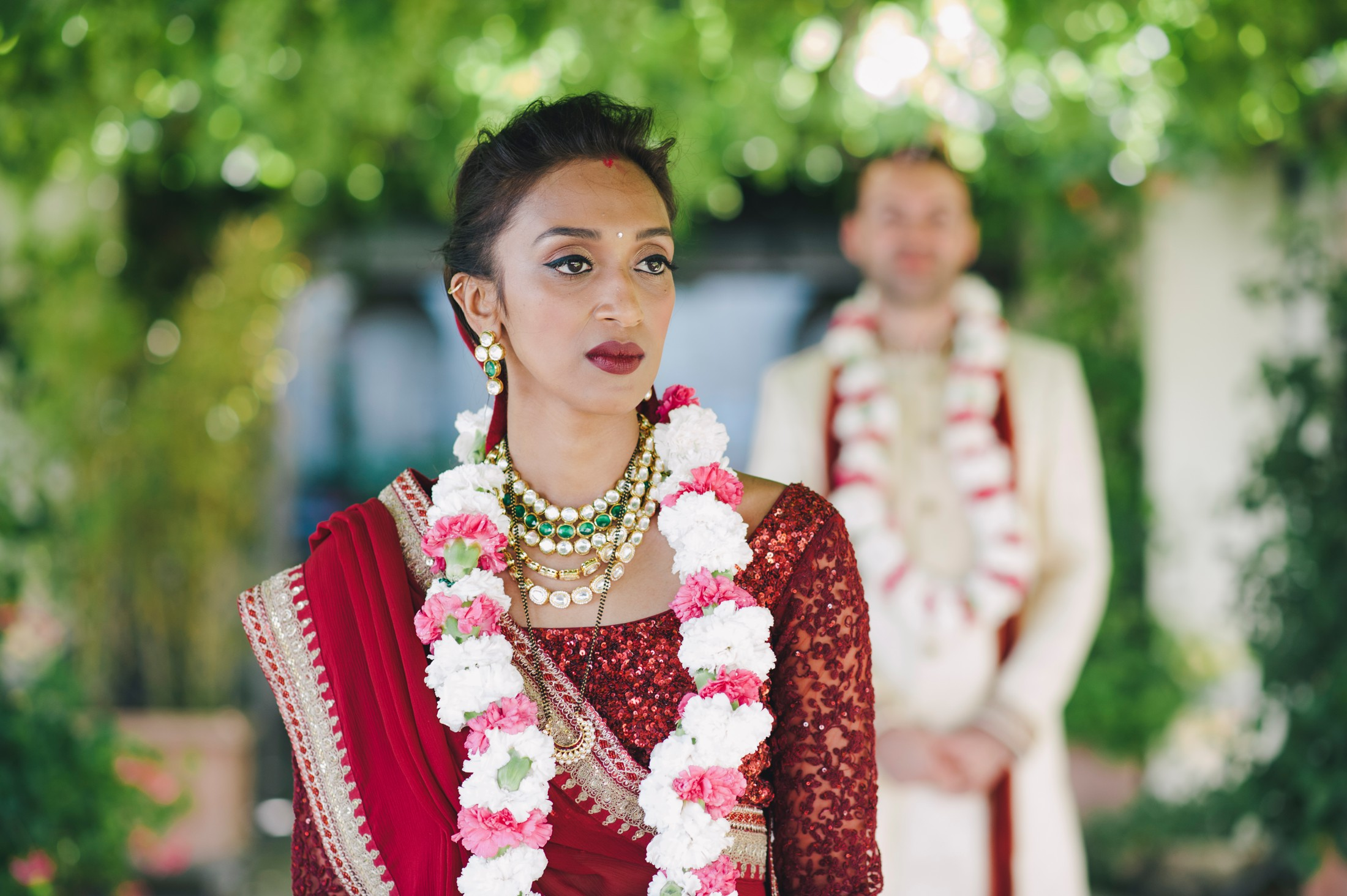 bride's portrait with the groom on the background
