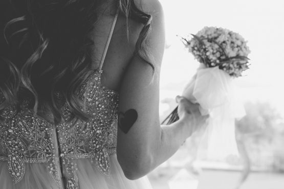 heart tatted on the bride's arm