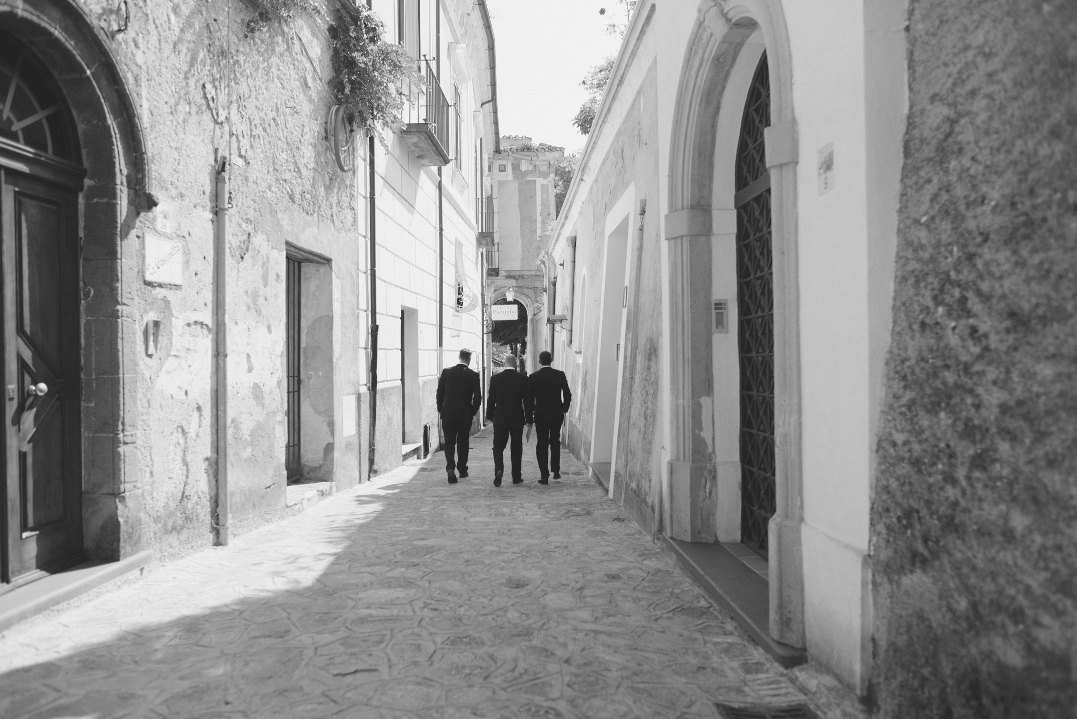 wedding in ravello the groom and the best men going to the wedding ceremony in black and white