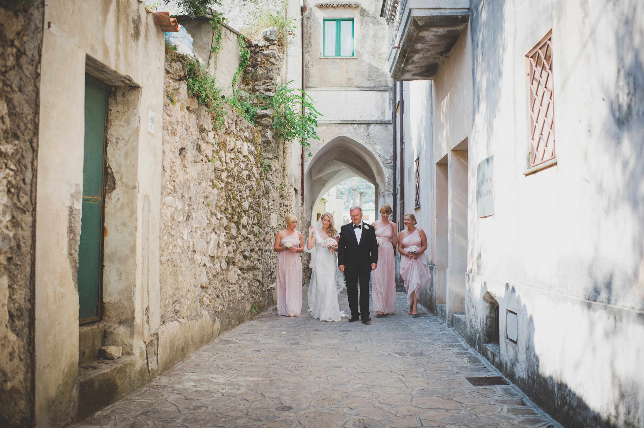 wedding in ravello the bride with her father and the bridesmaids walking to the wedding ceremony