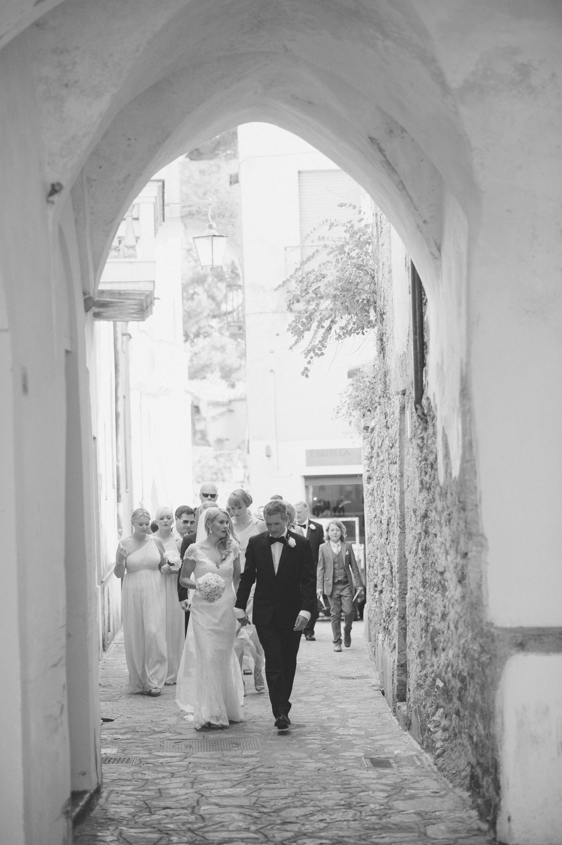 wedding in ravello bride and groom walking with other wedding guests