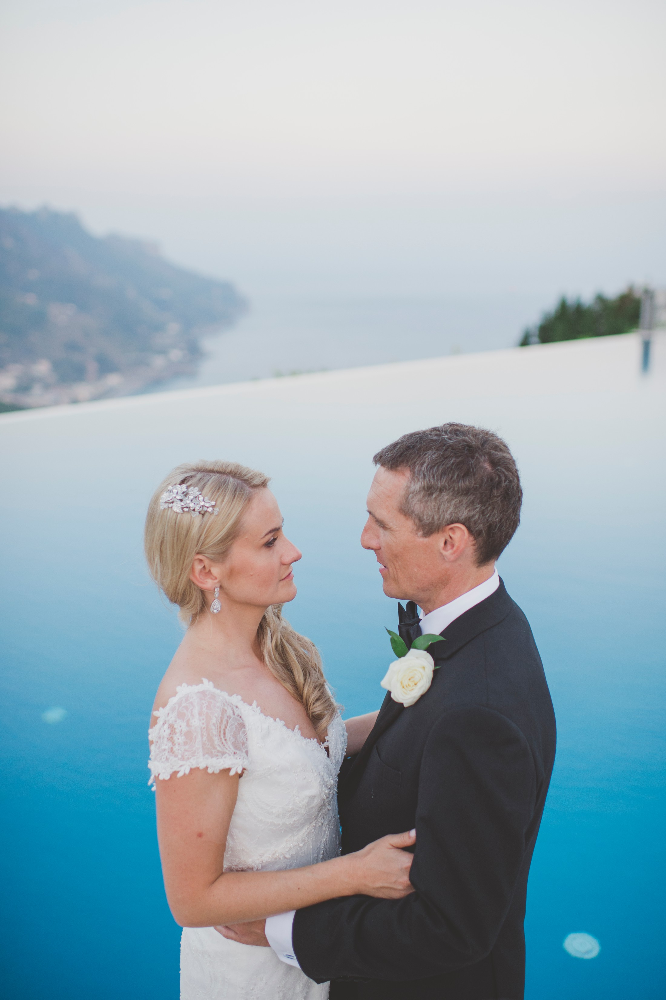wedding in ravello bride and groom's portrait by the infinity pool of the belmont hotel caruso