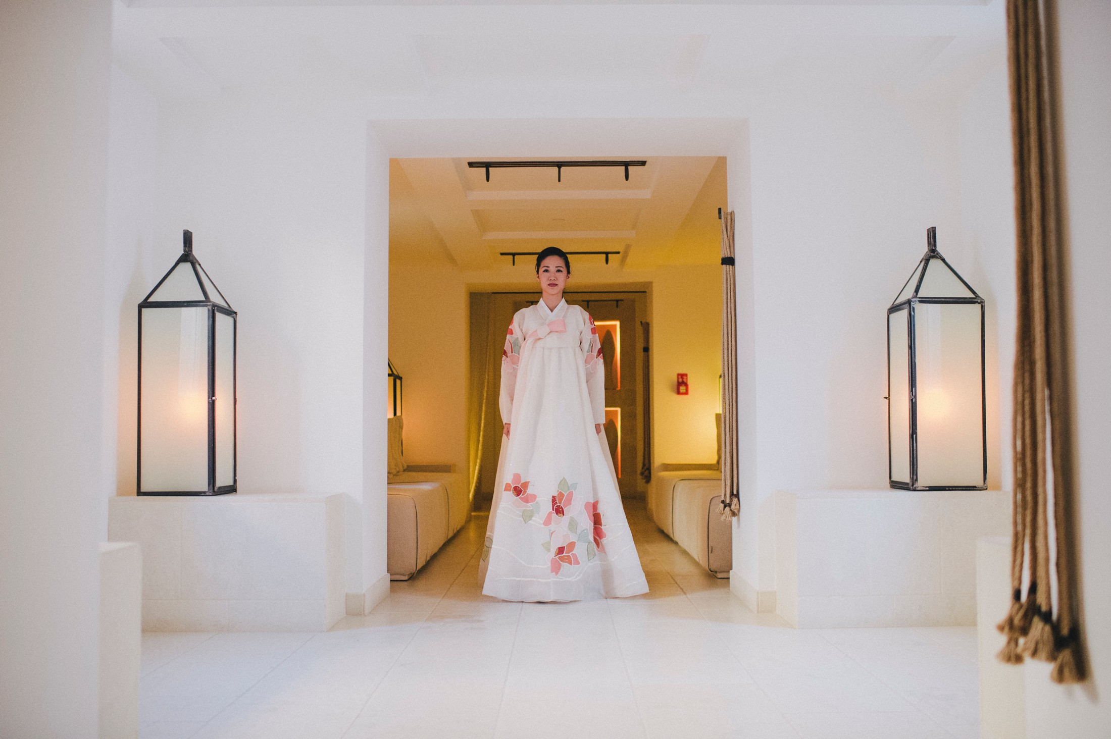 wedding guest in a traditional Korean dressat borgo Egnazia Apulia
