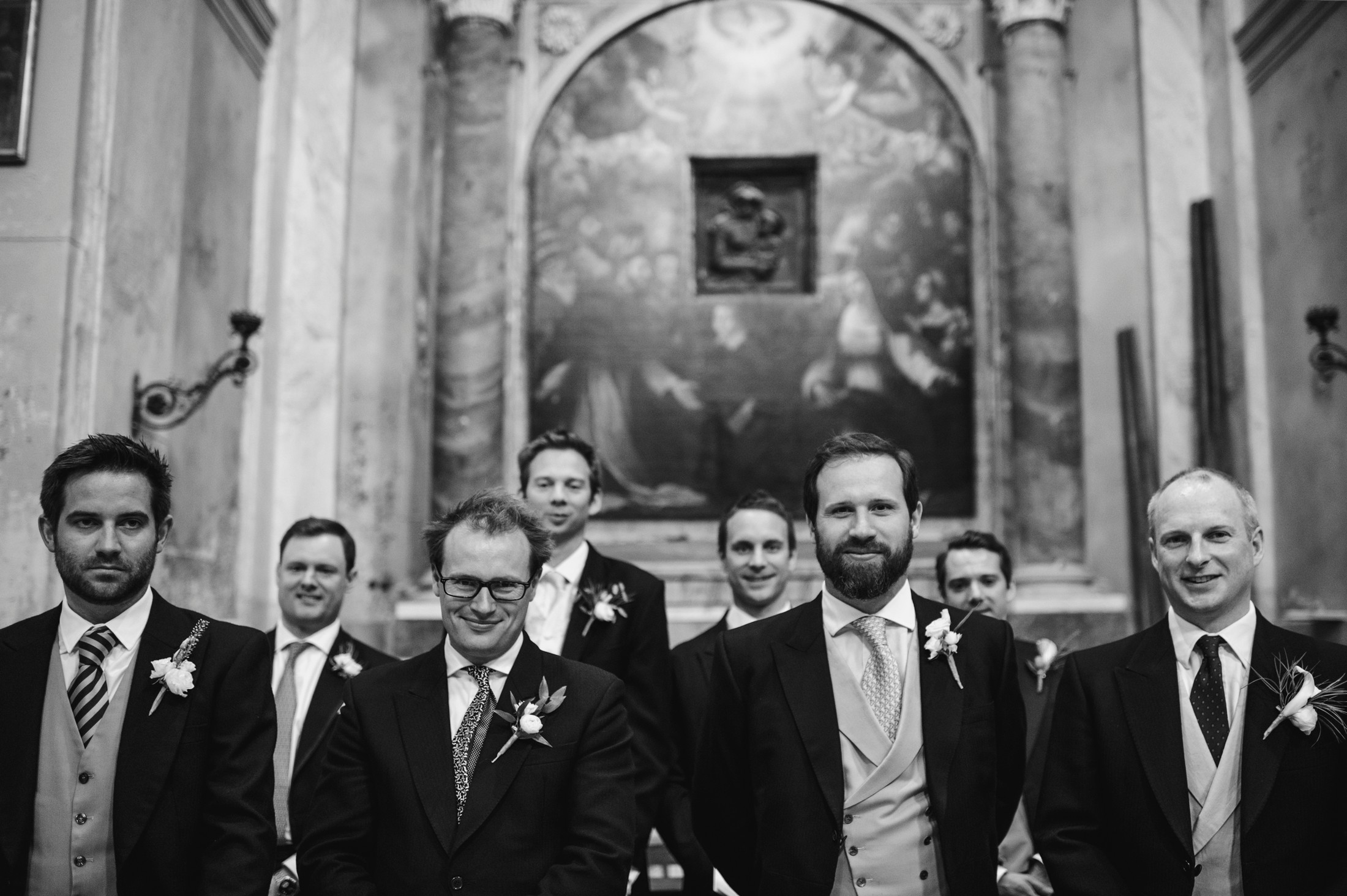wedding in rome the groom with some friends inside the church