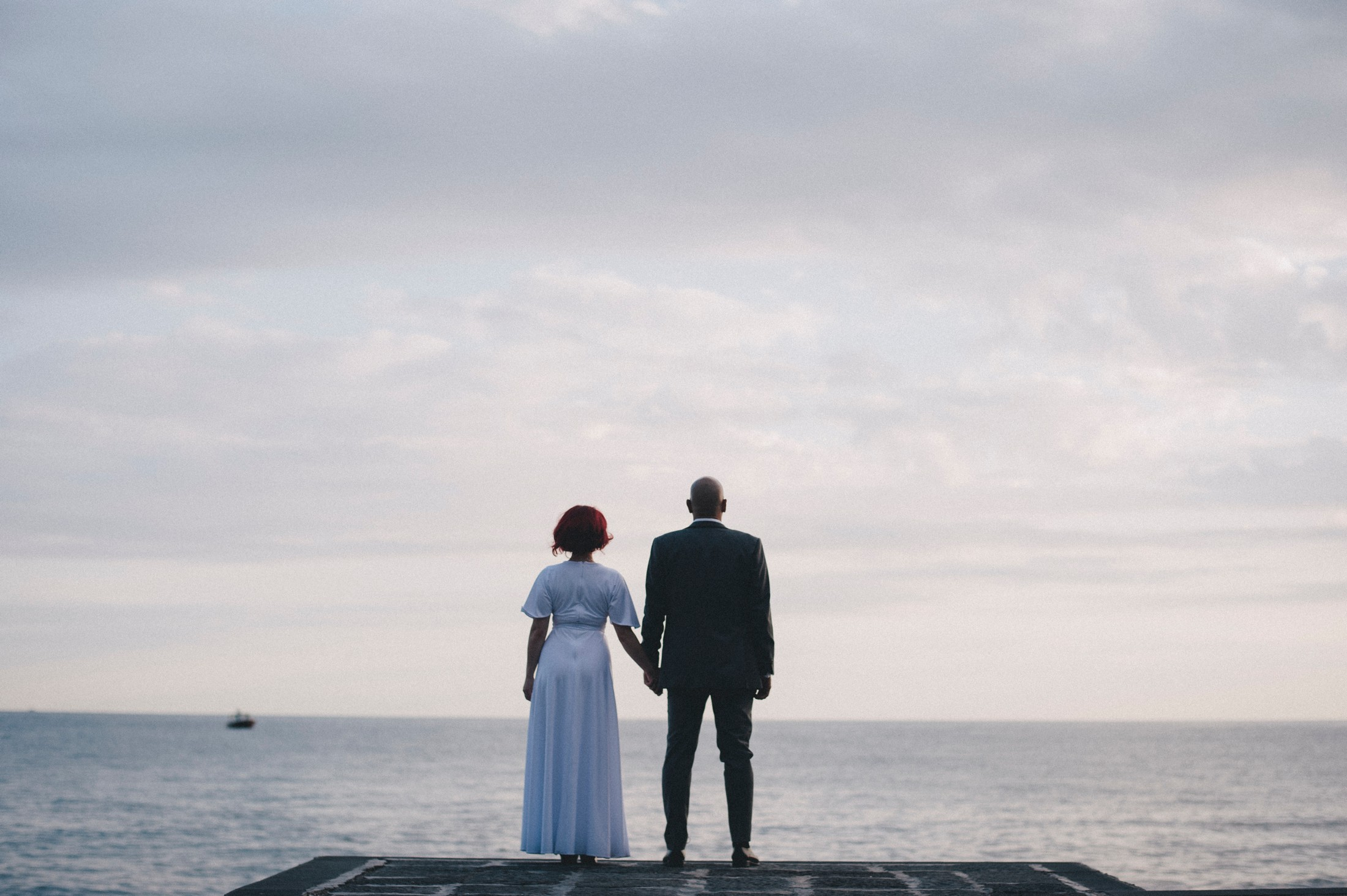 positano elopement bride and groom looking at the sea