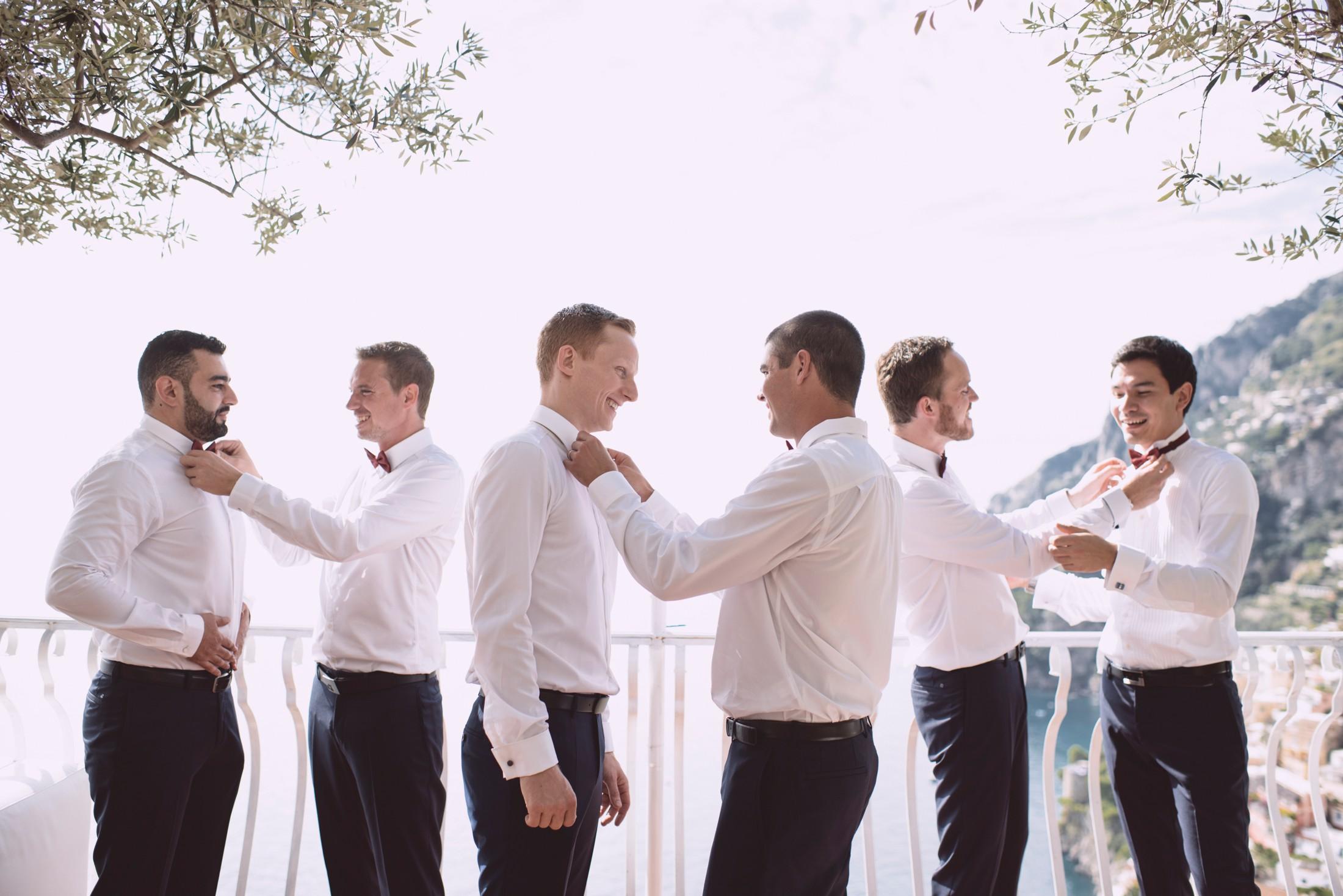 positano wedding groom and best men getting ready on the balcony