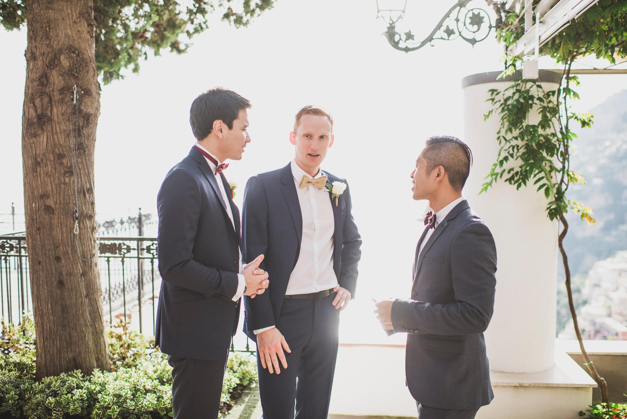 positano wedding groom talking with his friends