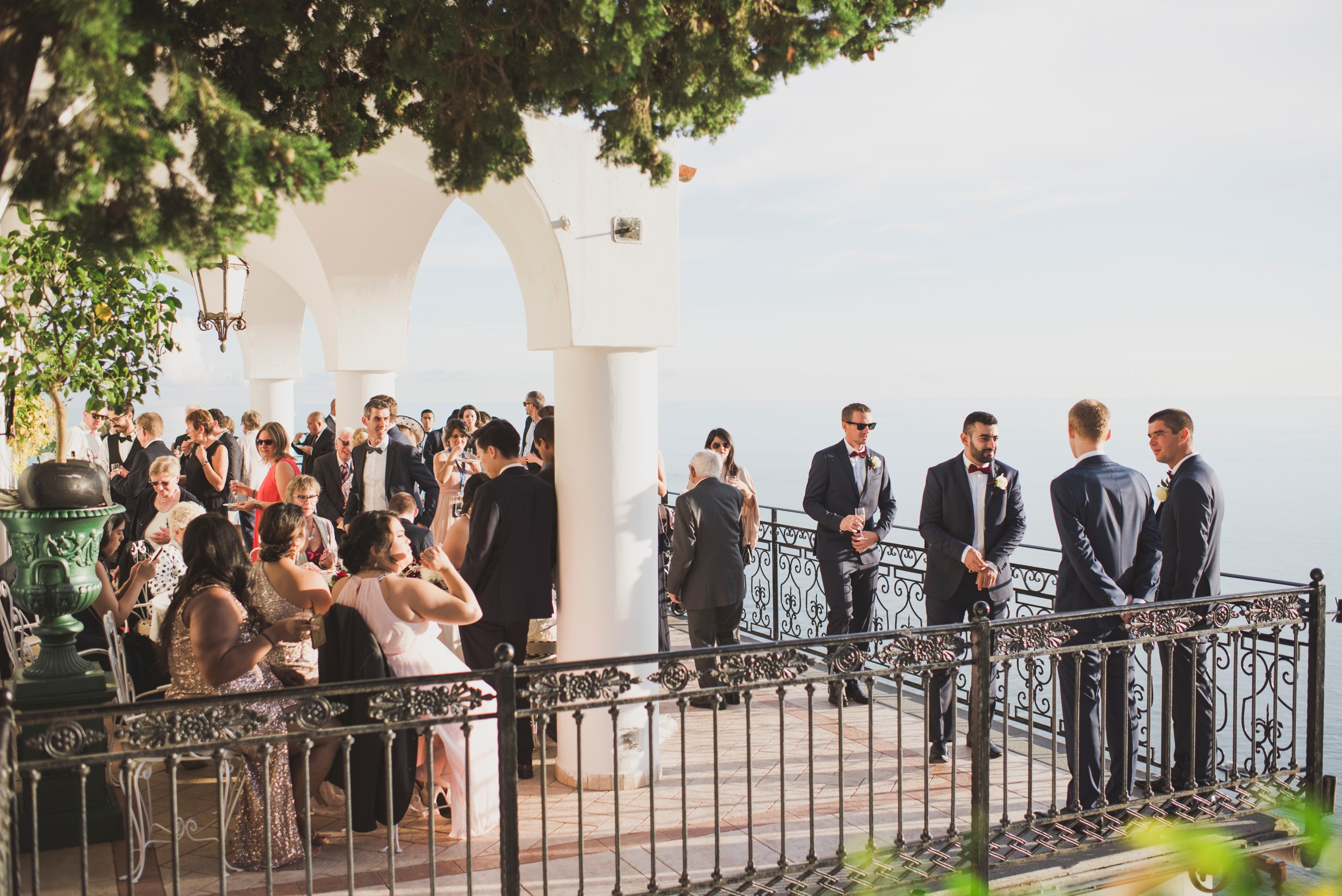 positano wedding guests on a terrace