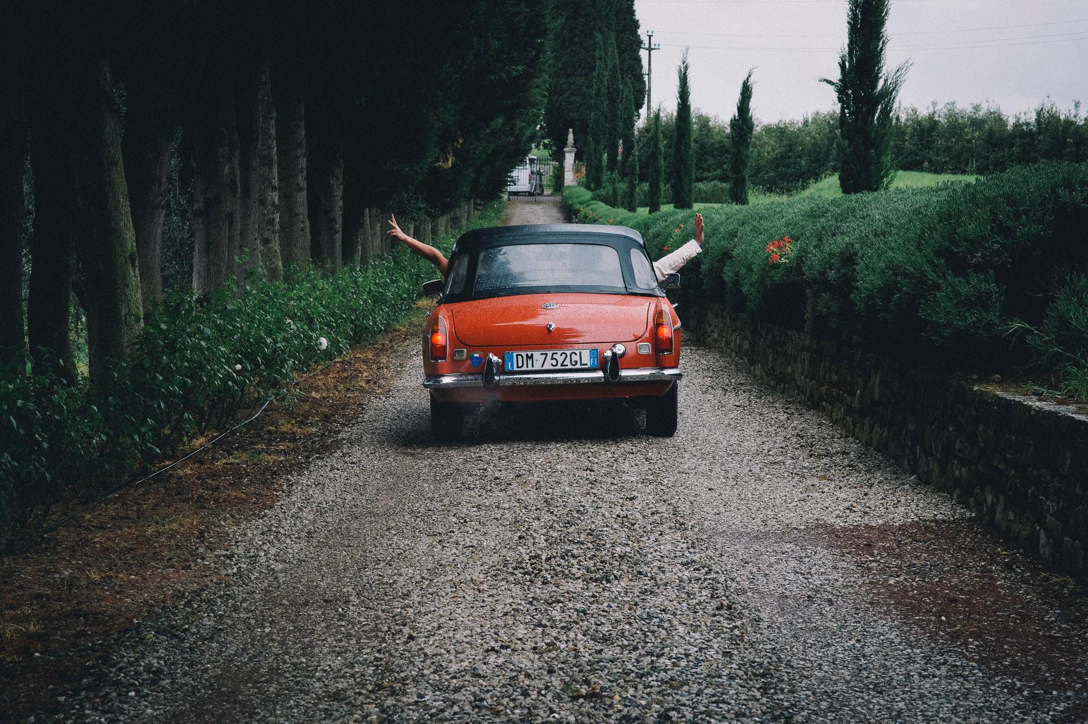red wedding car at villa mangiacane florence