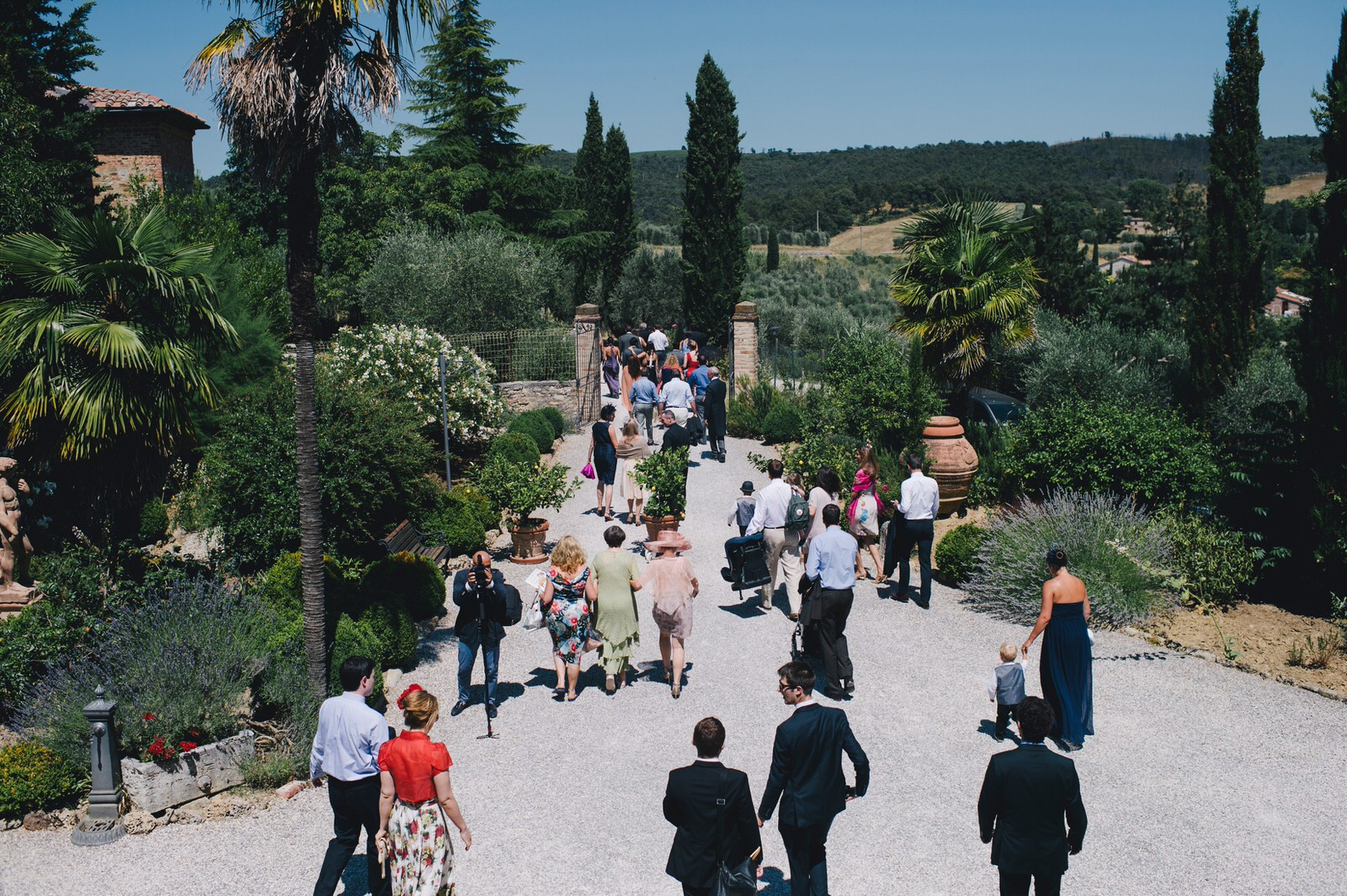 tuscany wedding guests going to the ceremony