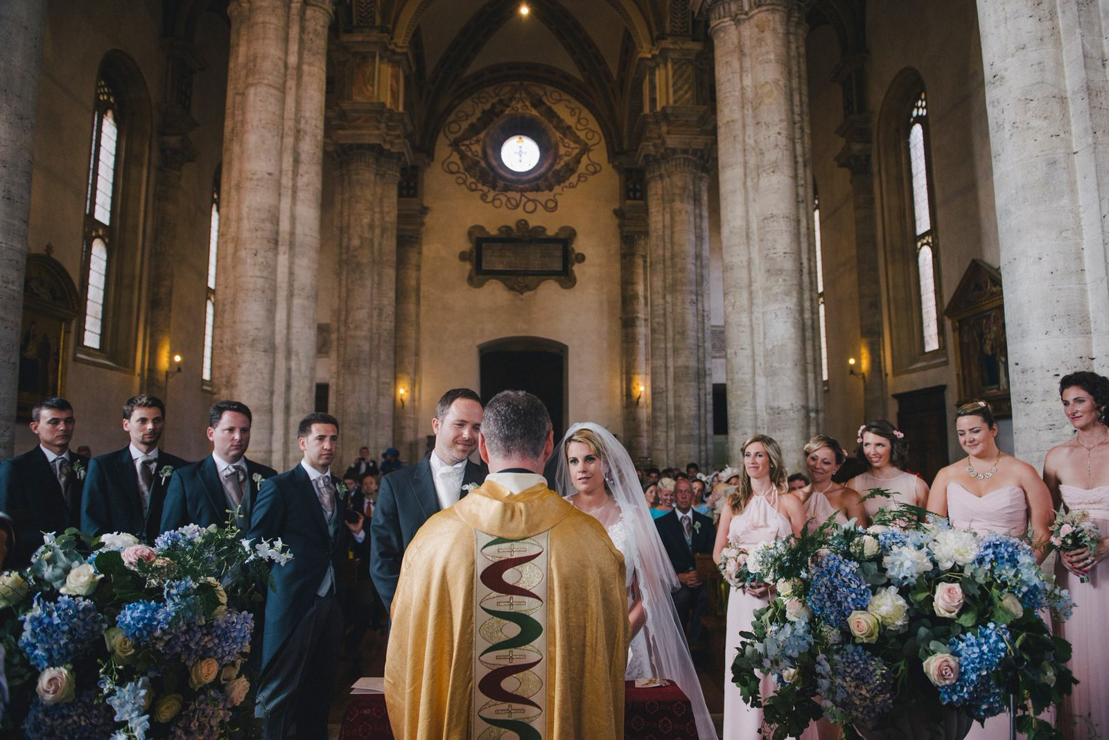 tuscany wedding bride, groom and witnesses inside the church