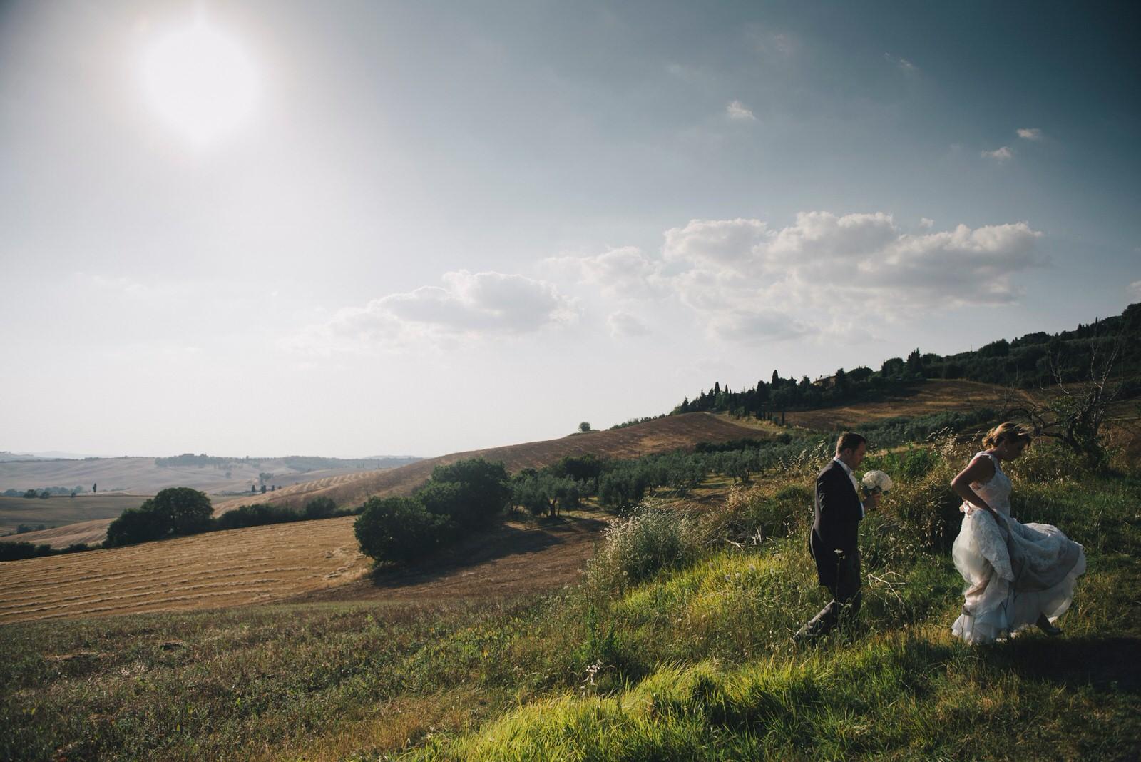 tuscany wedding bride and groom walking hand by hand