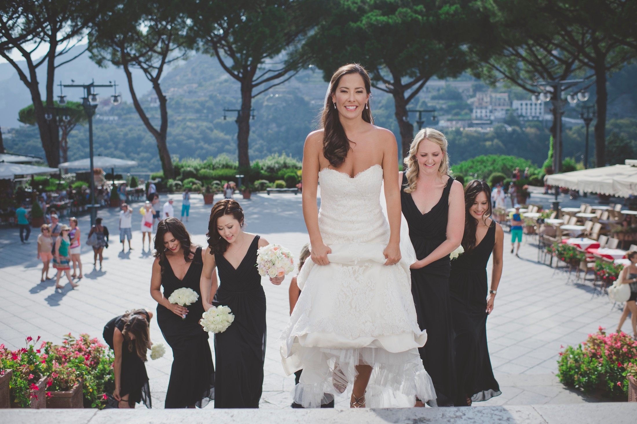 wedding in ravello the bride with her bridesmaids walking to the church