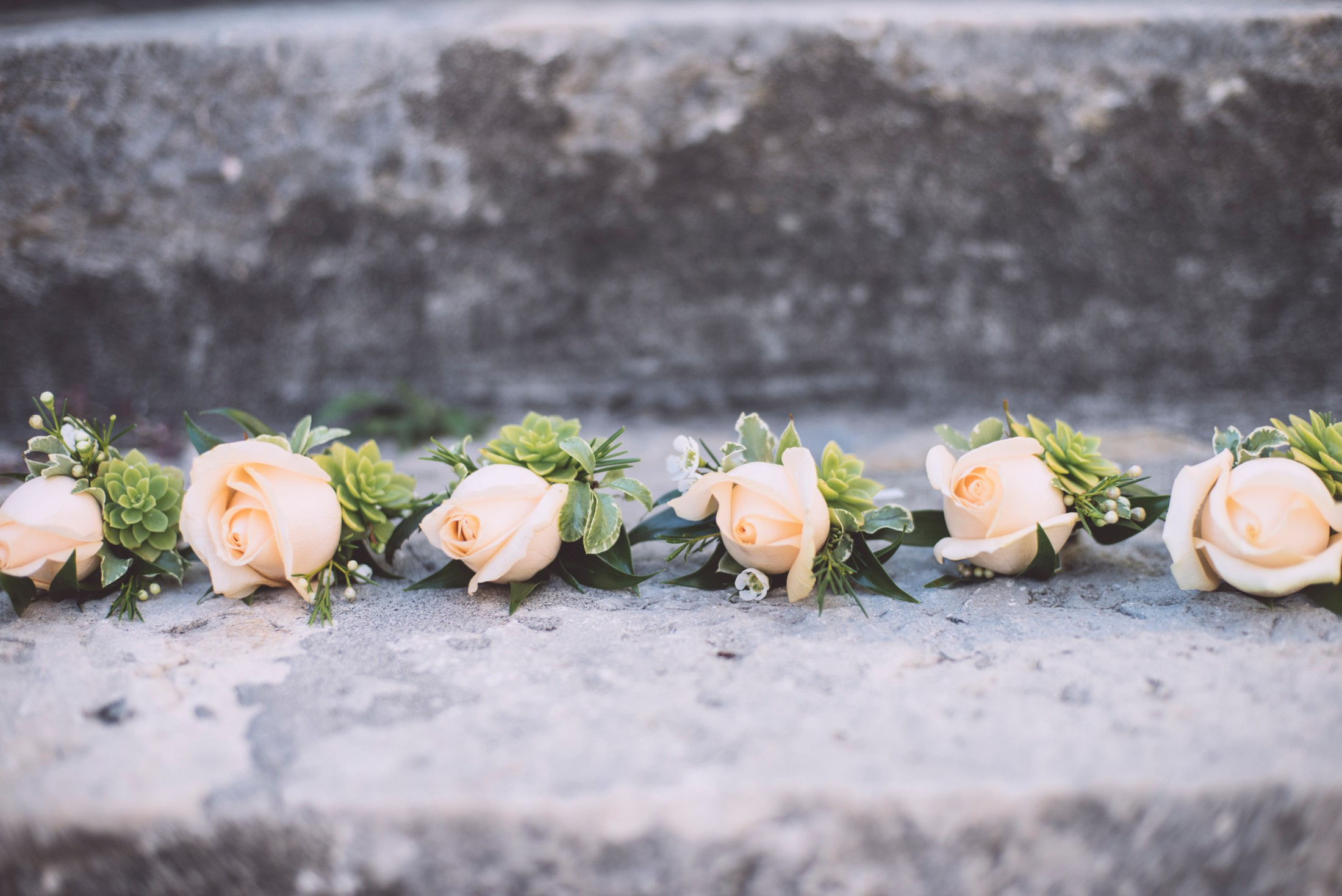 wedding in ravello boutonnieres made in pink roses