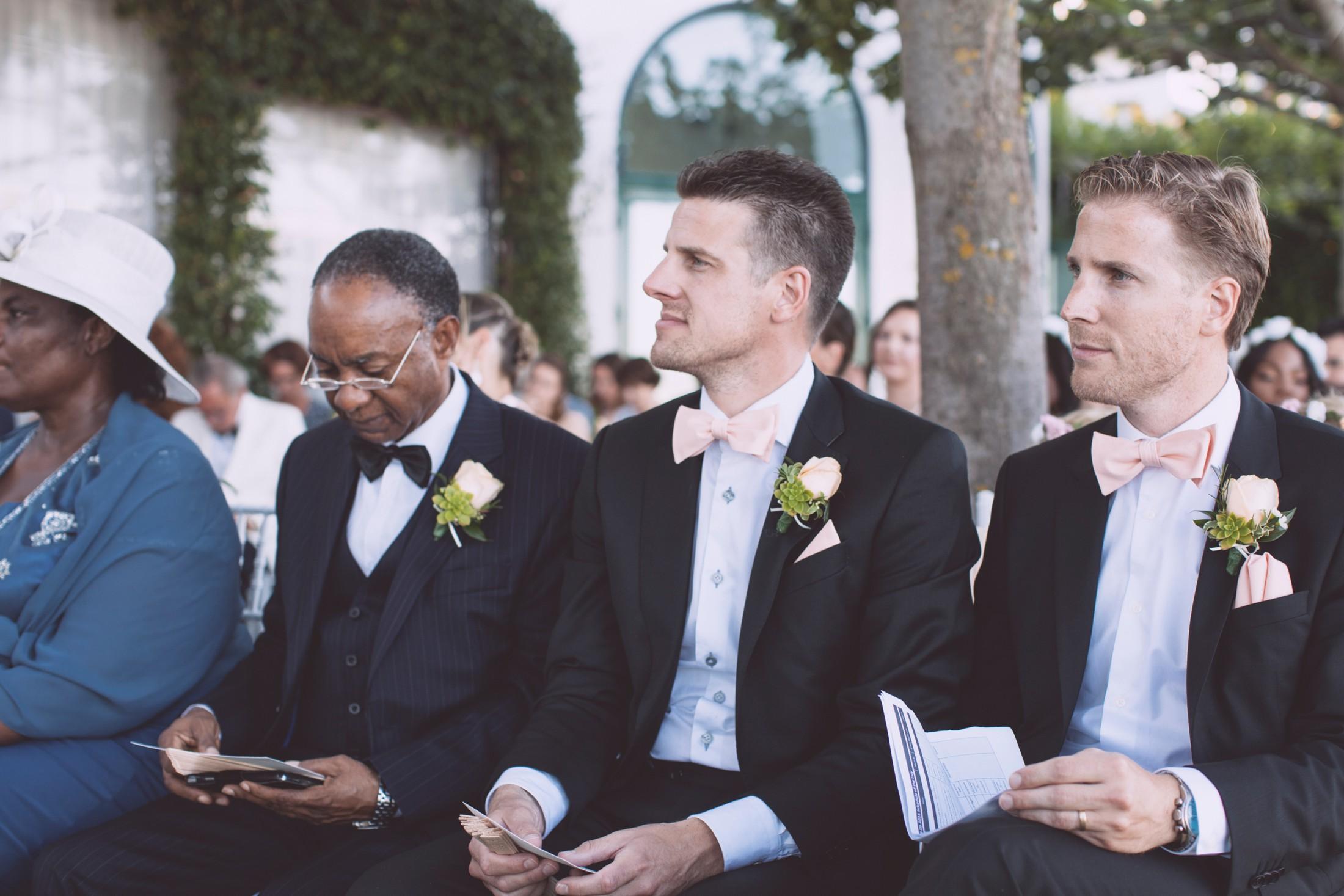 wedding ceremony best men during the ceremony