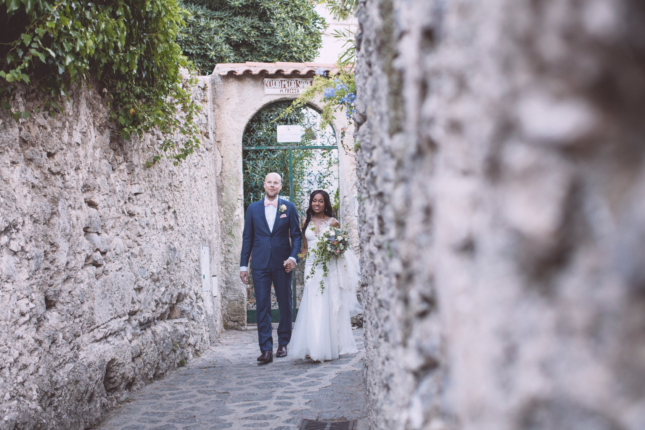 wedding in ravello the bride and the groom walking in a narrow street in ravello