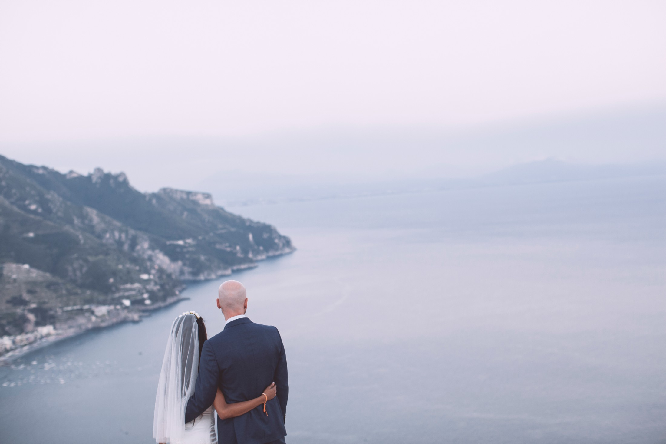 wedding in ravello bride and groom portrait on the roof of villa eva with amalfi coast landscape on the background