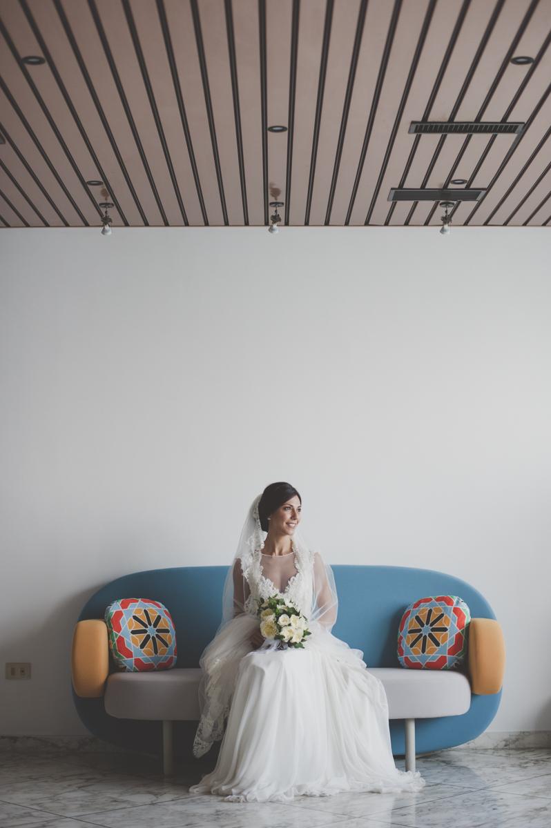 wedding in amalfi bride's portrait sitting on a sofa