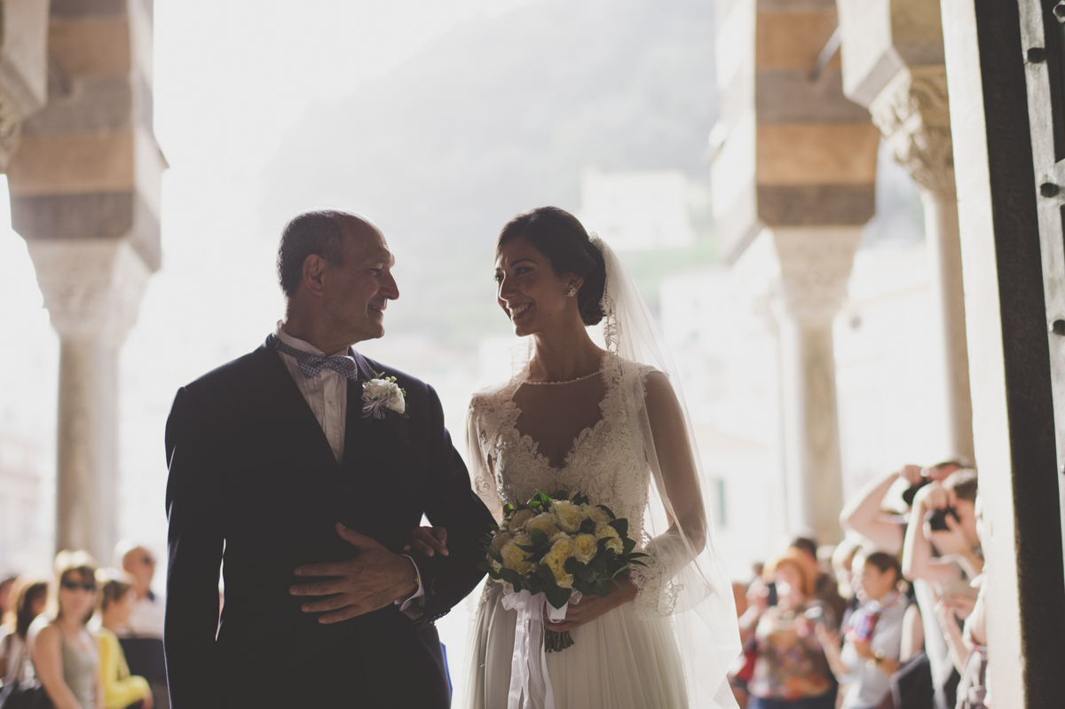wedding in amalfi the bride with her father outside the church