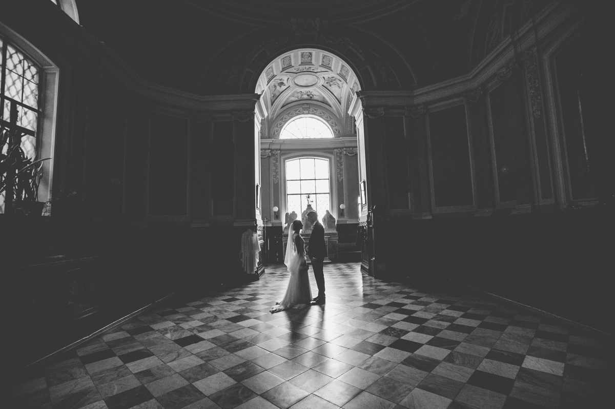 wedding in amalfi the bride and the groom' s portrait inside the church in black and white