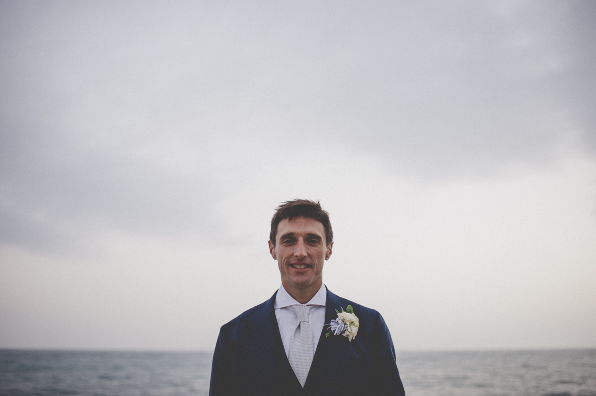 wedding in amalfi grooms' portrait by the sea