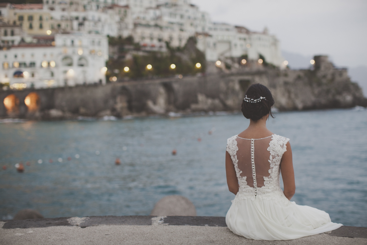 wedding in amalfi the bride sitting and looking at the sea