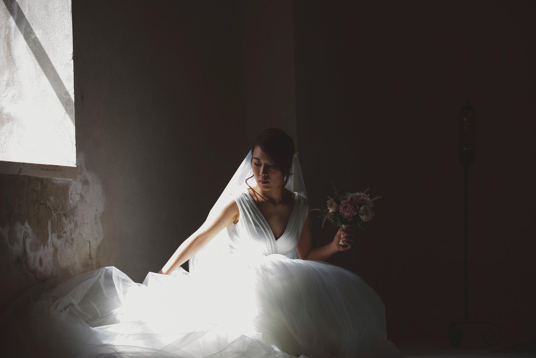 wedding on the amalfi coast the bride adjusts her dress