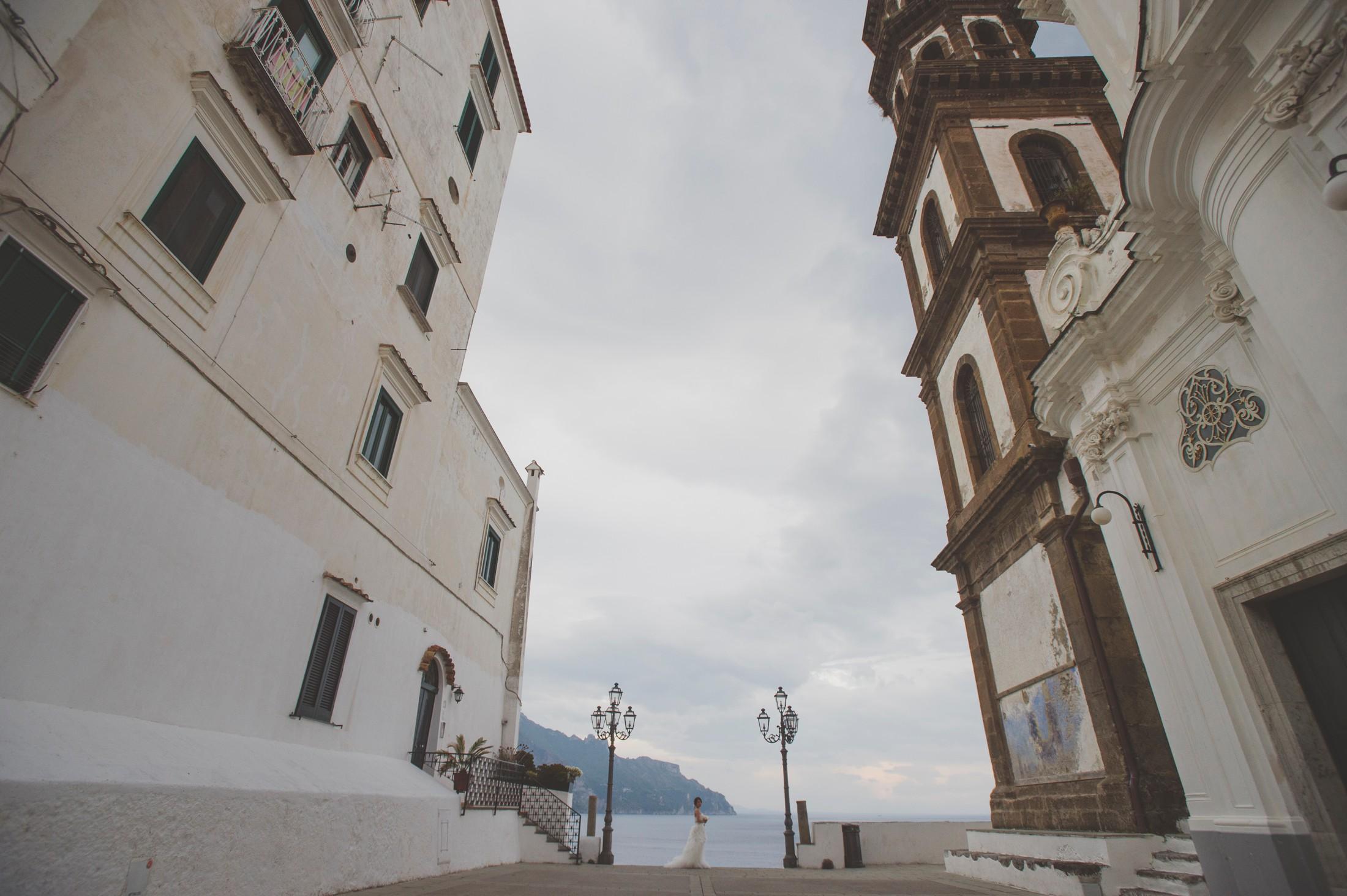 wedding on the amalfi coast bride's portrait standing in a small square in Atrani