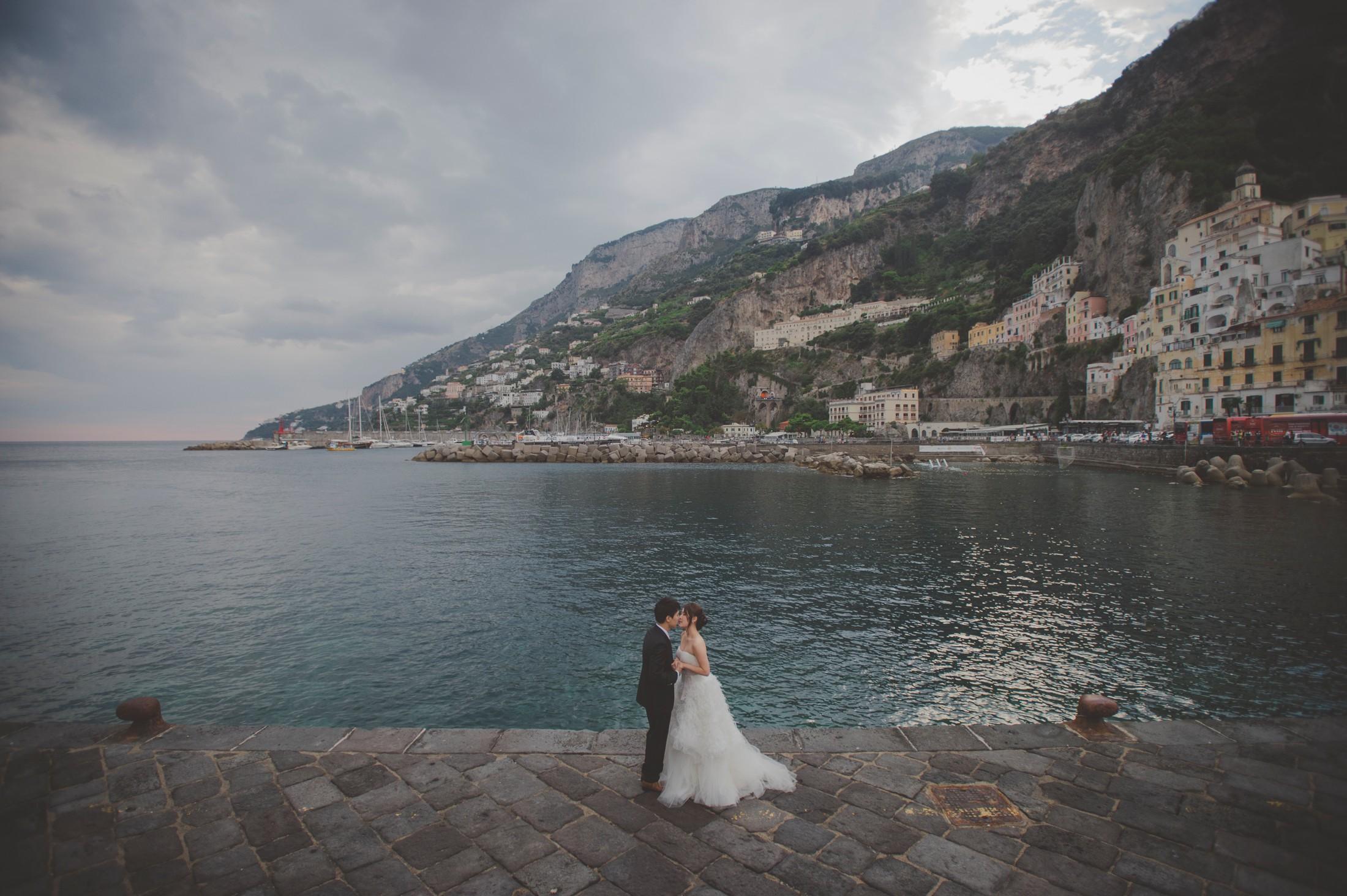 wedding on the amalfi coast bride and groom's portrait by the sea in Amalfi