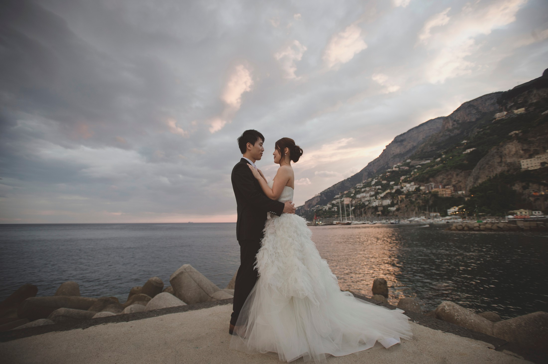 wedding on the amalfi coast the bride and the groom facing each other by the sea