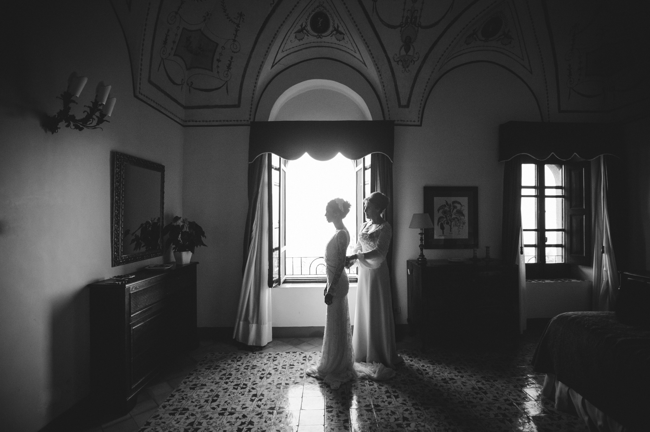 luxury wedding bride getting dressed with her mother