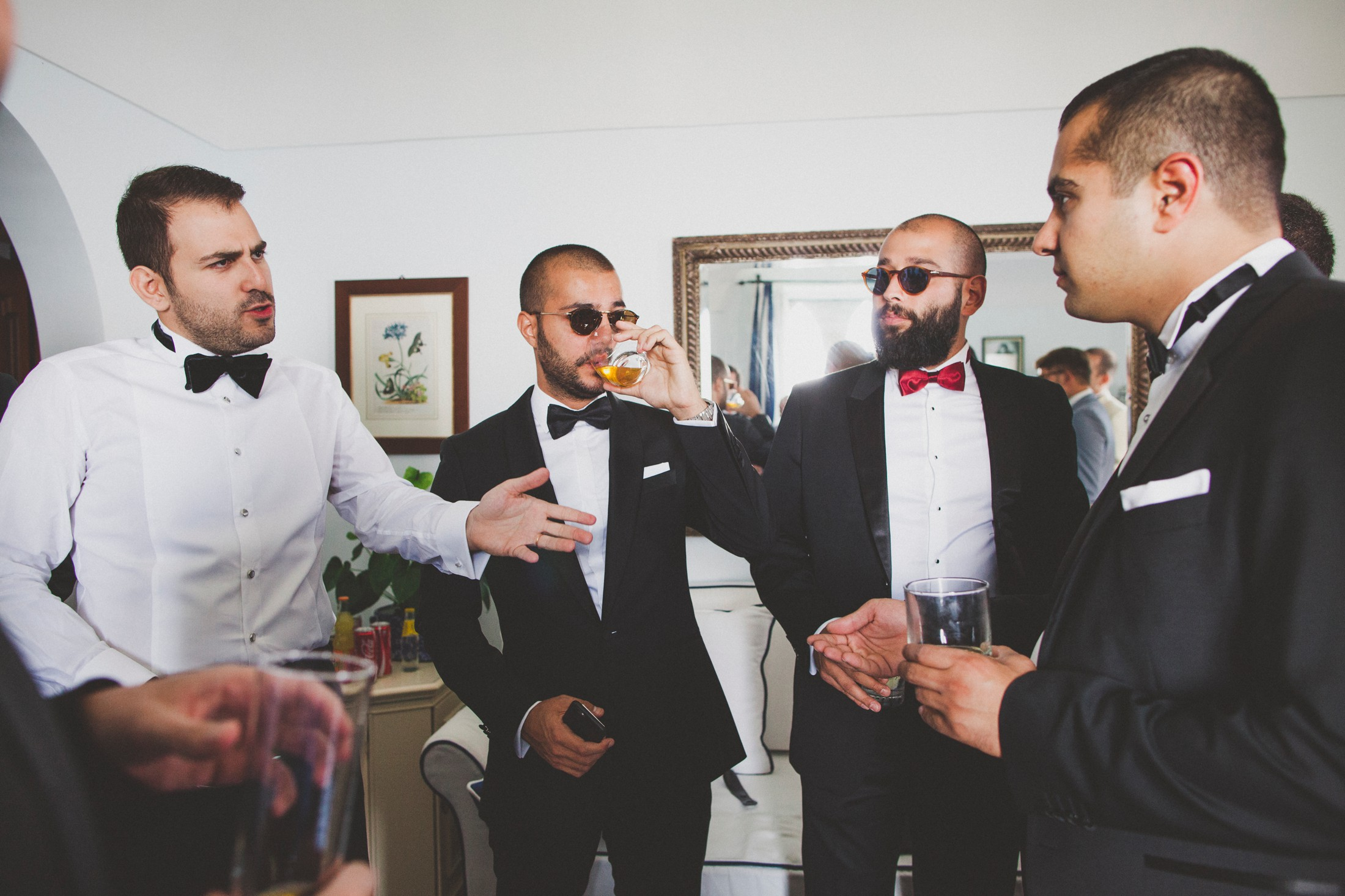 luxury wedding the groom with some friends having a toast